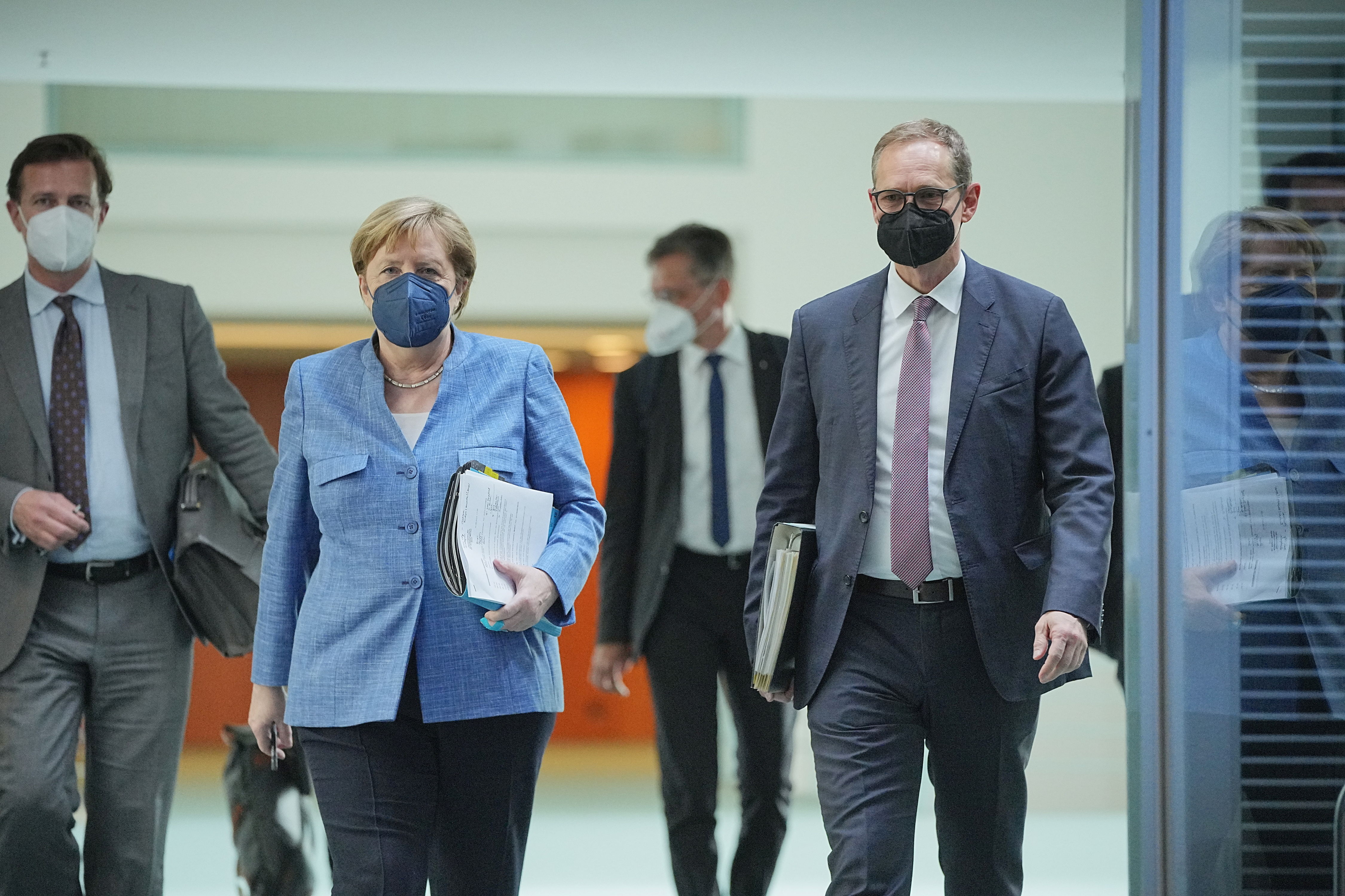 German Chancellor Angela Merkel and Mayor of Berlin Michael Mueller arrive for a news conference after a meeting with the leaders of the country's 16 federal states to discuss COVID-19 measurements in Berlin, Germany, June 10, 2021.   Michael Kappeler/Pool via REUTERS