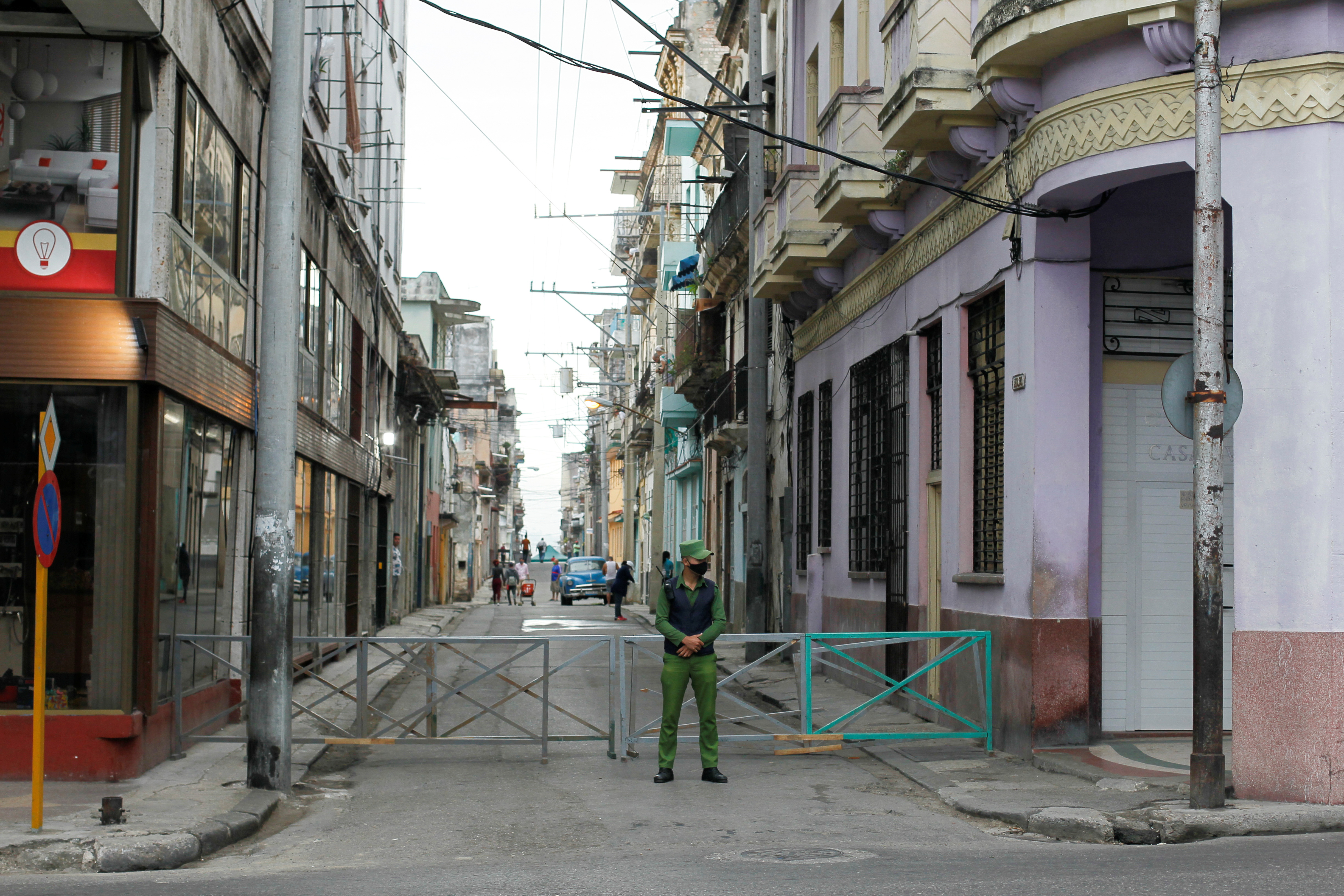 A police officer stands in front of a street in quarantine amid concerns about the spread of the coronavirus disease (COVID-19) in Havana, Cuba, February 1, 2021. REUTERS/Stringer