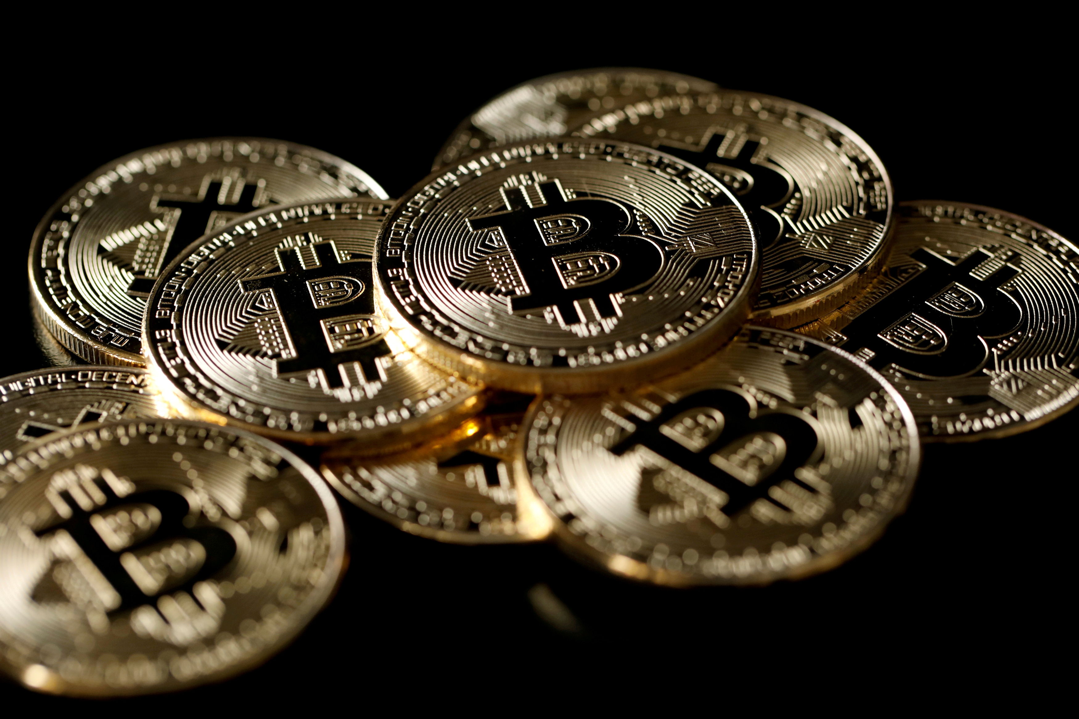 A collection of Bitcoin (virtual currency) tokens are displayed in this picture illustration taken Dec. 8, 2017. REUTERS/Benoit Tessier/Illustration