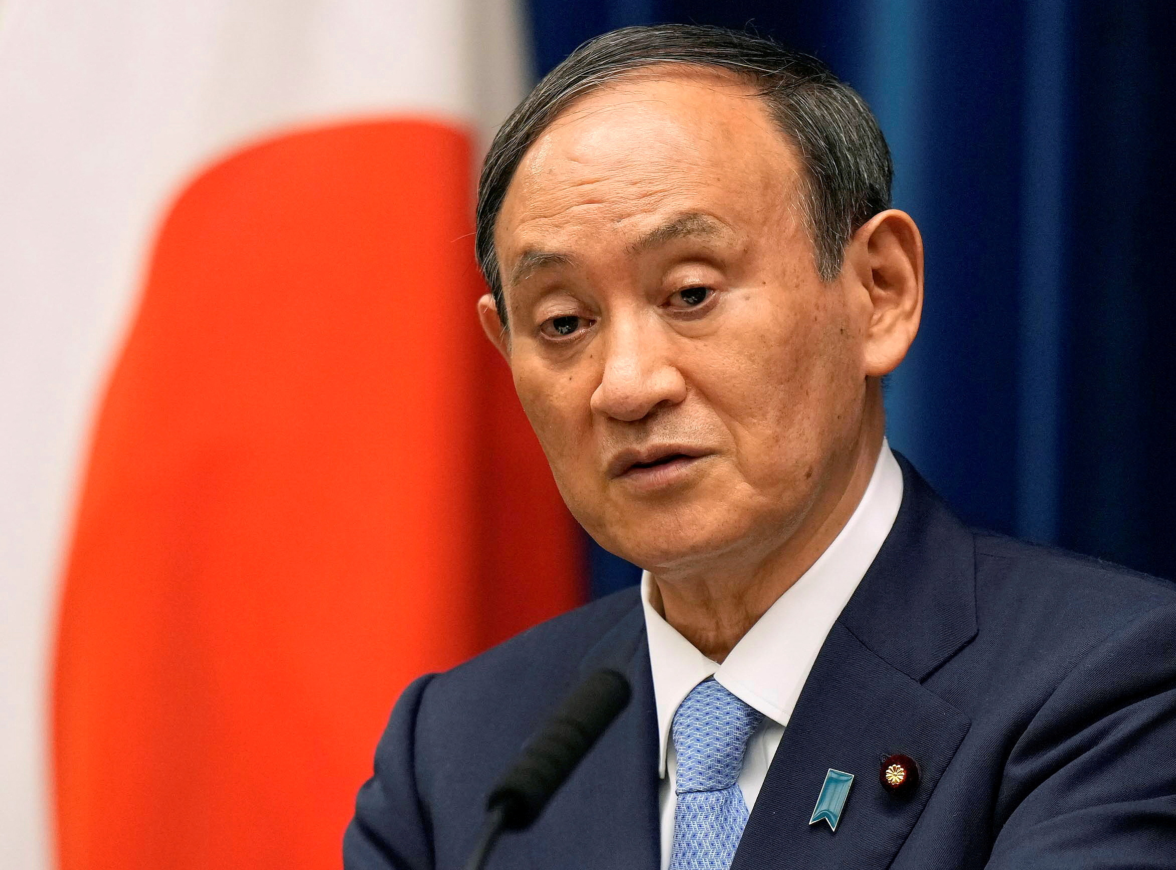 Japanese Prime Minister Yoshihide Suga speaks during a news conference announcing to extend a state of emergency on COVID-19 pandemic at prime minister's official residence in Tokyo, Japan, August 17, 2021. Kimimasa Mayama/Pool via REUTERS//File Photo
