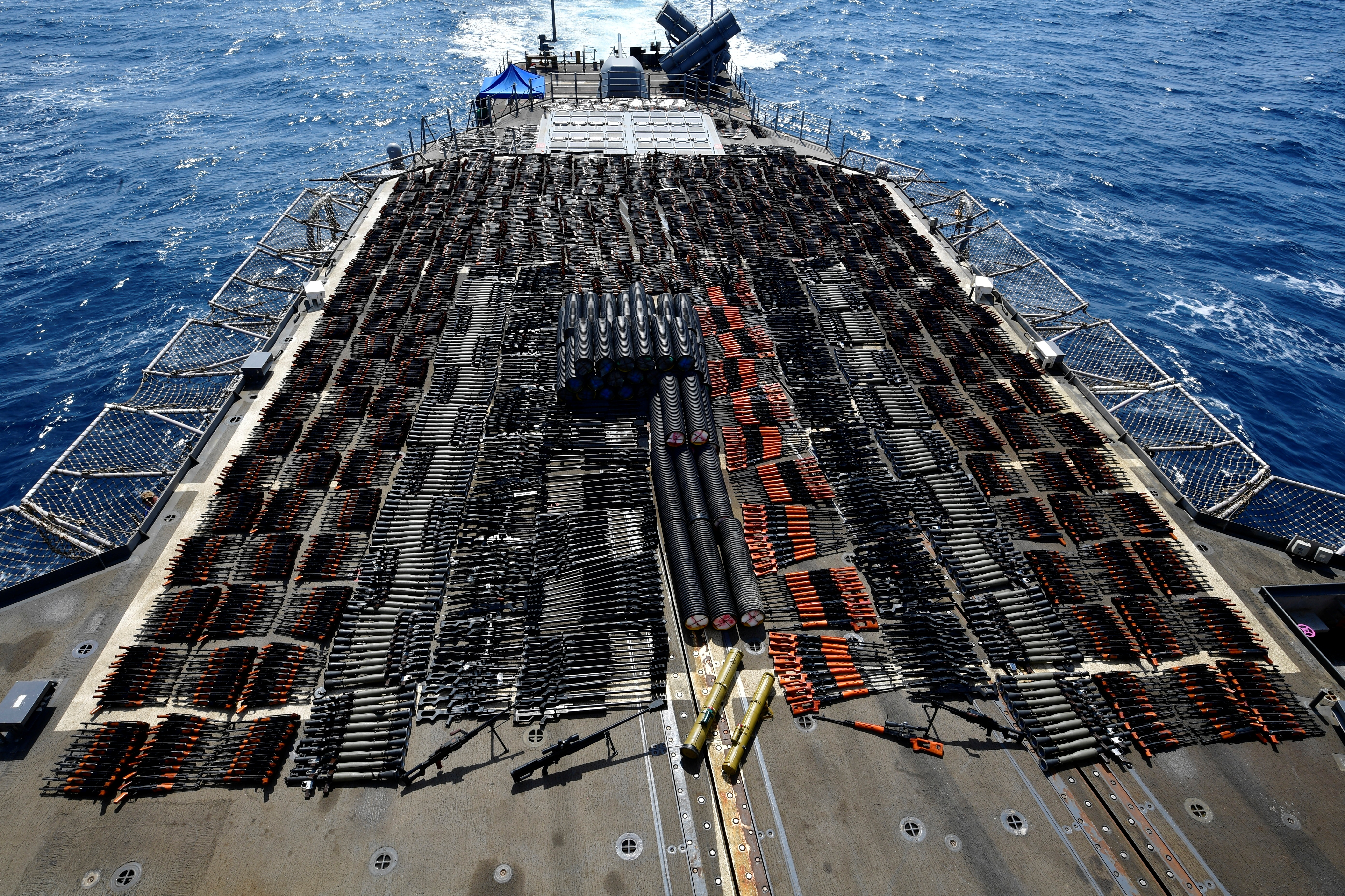 Thousands of illicit weapons are displayed onboard the guided-missile cruiser USS Monterey (CG 61) which was seized from a stateless dhow in international waters of the North Arabian Sea in this picture taken on May 8, 2021 and released by U.S.Navy on May 9, 2021. U.S. Navy Forces Central Command/U.S. Navy/Handout via REUTERS