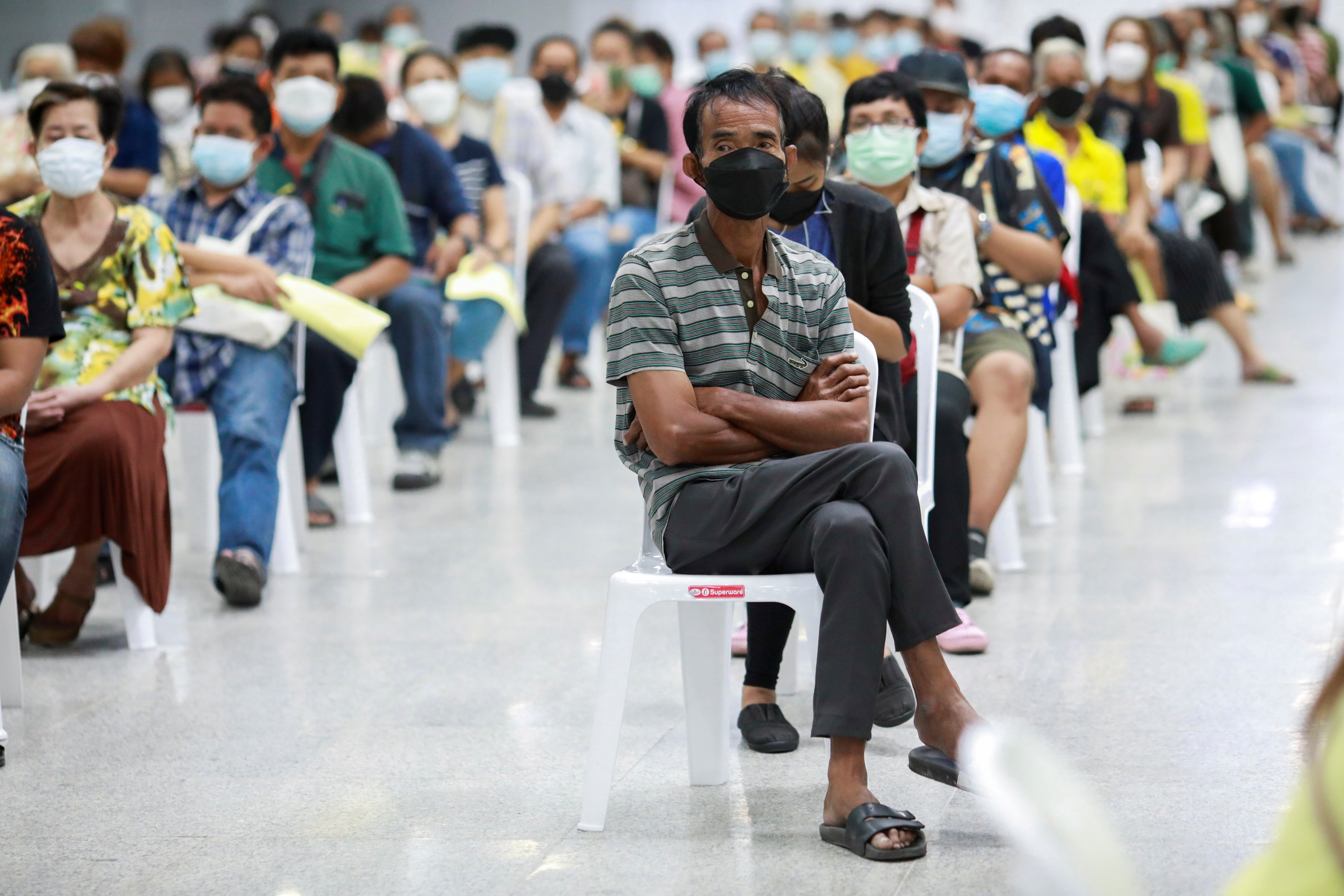 People queue at the Central Vaccination Center as Thailand begins offering first doses of the AstraZeneca vaccine to at-risk groups amid the coronavirus (COVID-19) outbreak in Bangkok, Thailand, July 26, 2021. REUTERS/Soe Zeya Tun