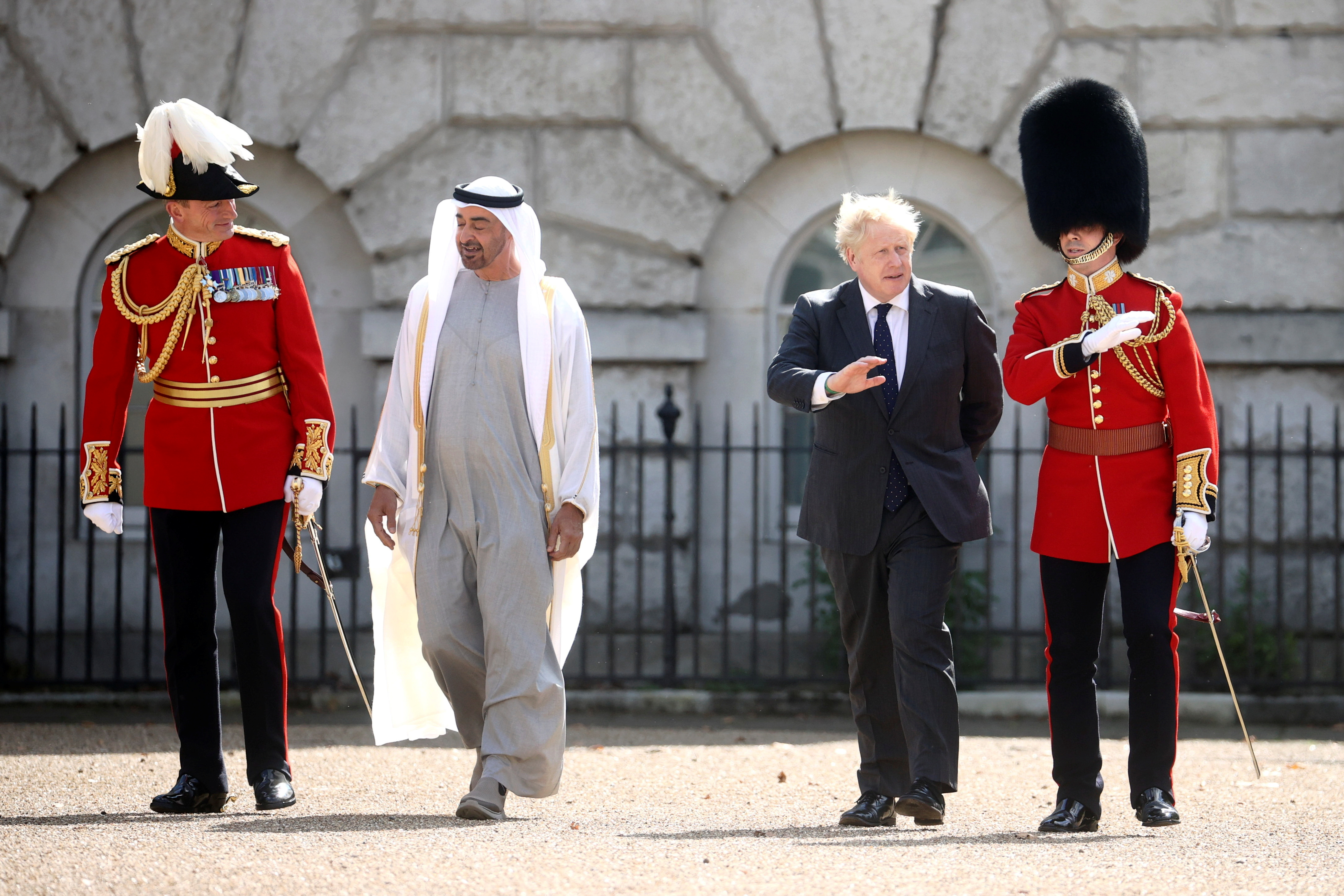 Britain's Prime Minister Boris Johnson and Abu Dhabi's Crown Prince Sheikh Mohammed bin Zayed al-Nahyan inspect the Guard of Honour in London, Britain, September 16, 2021. REUTERS/Hannah McKay