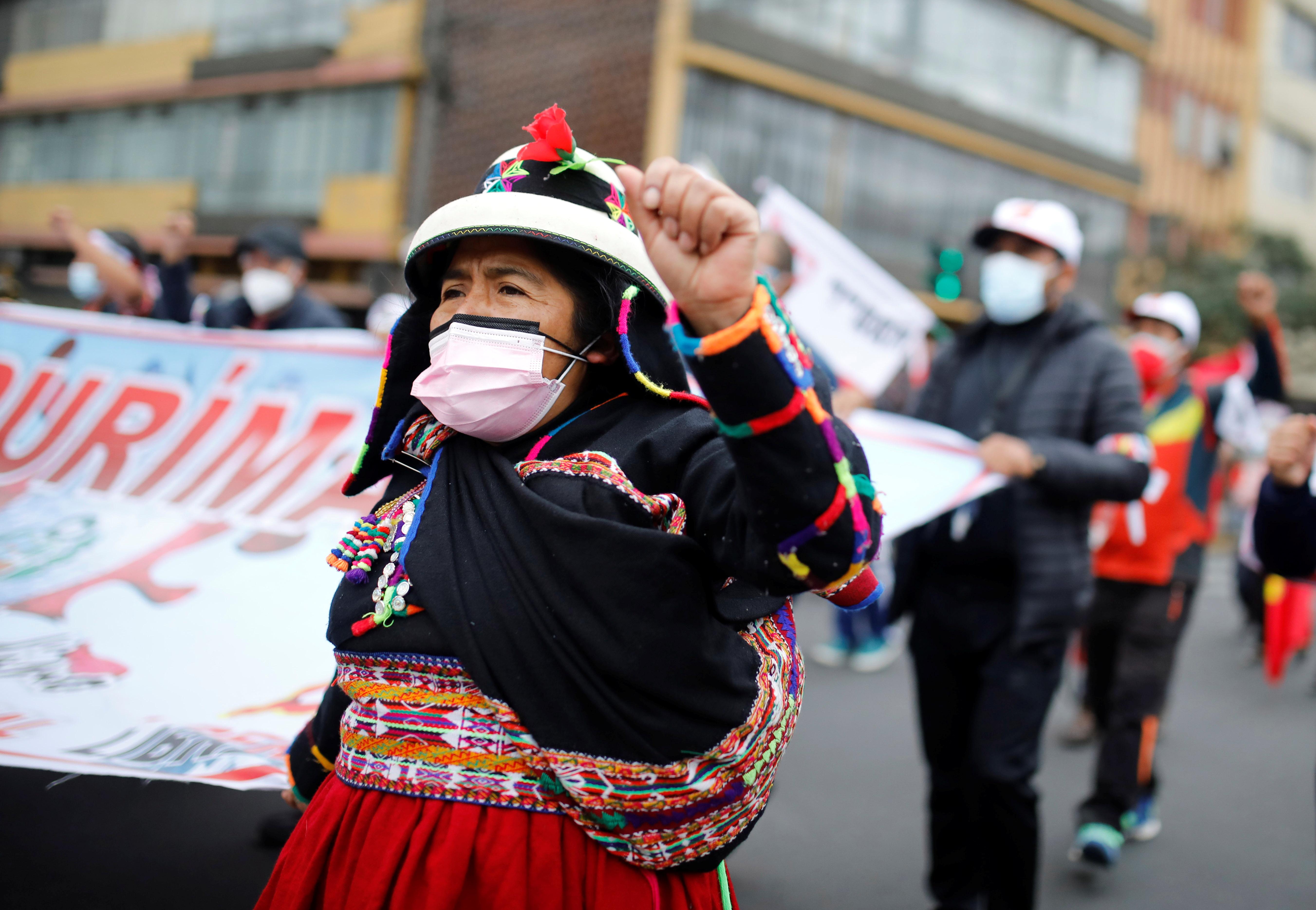 Supporters of Peru's presidential candidate Pedro Castillo march in Lima, Peru June 26, 2021. REUTERS/Sebastian Castaneda