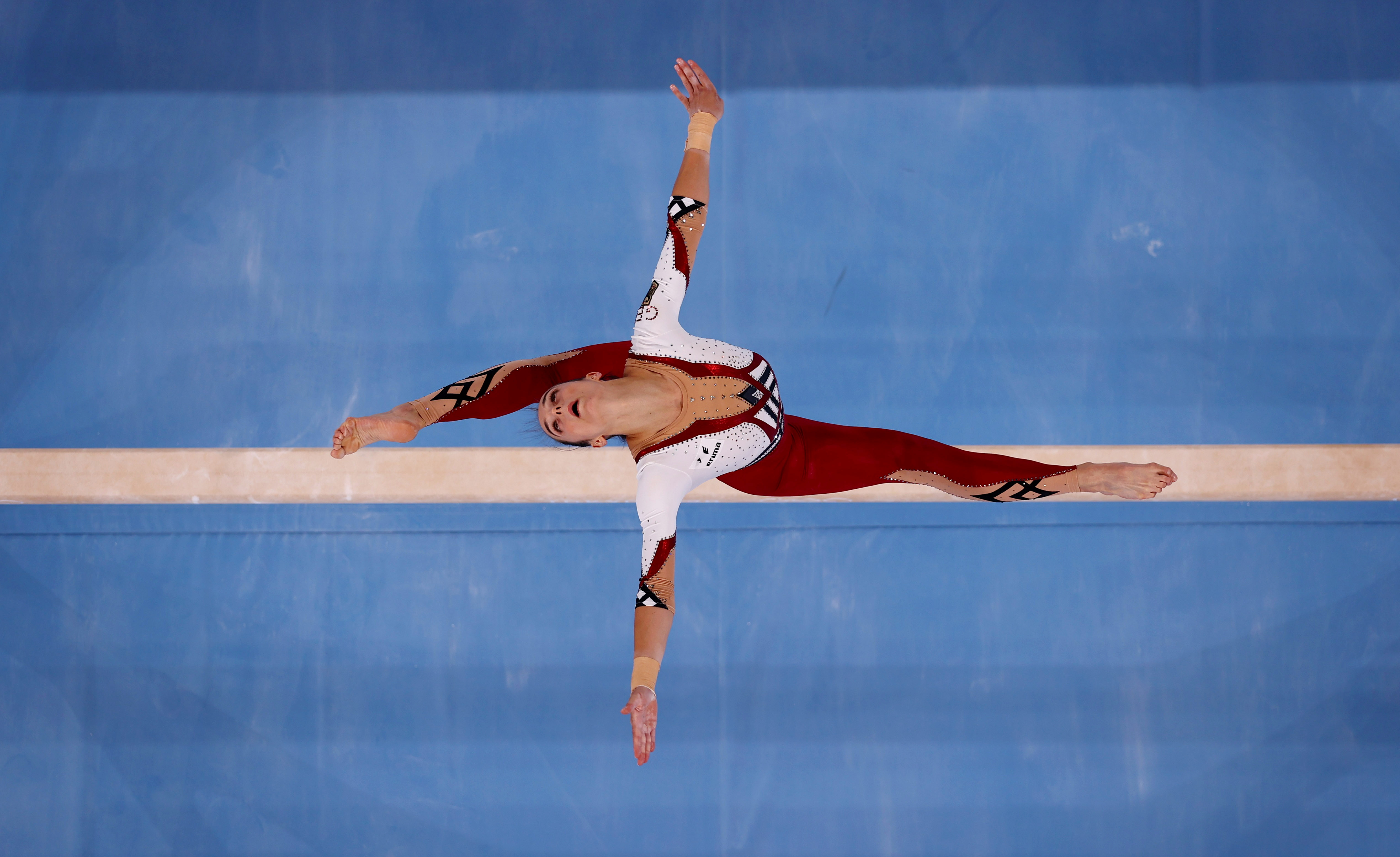 Tokyo 2020 Olympics - Gymnastics - Artistic - Women's Beam - Qualification - Ariake Gymnastics Centre, Tokyo, Japan - July 25, 2021.   Pauline Schaefer of Germany in action on the beam. REUTERS/Athit Perawongmetha