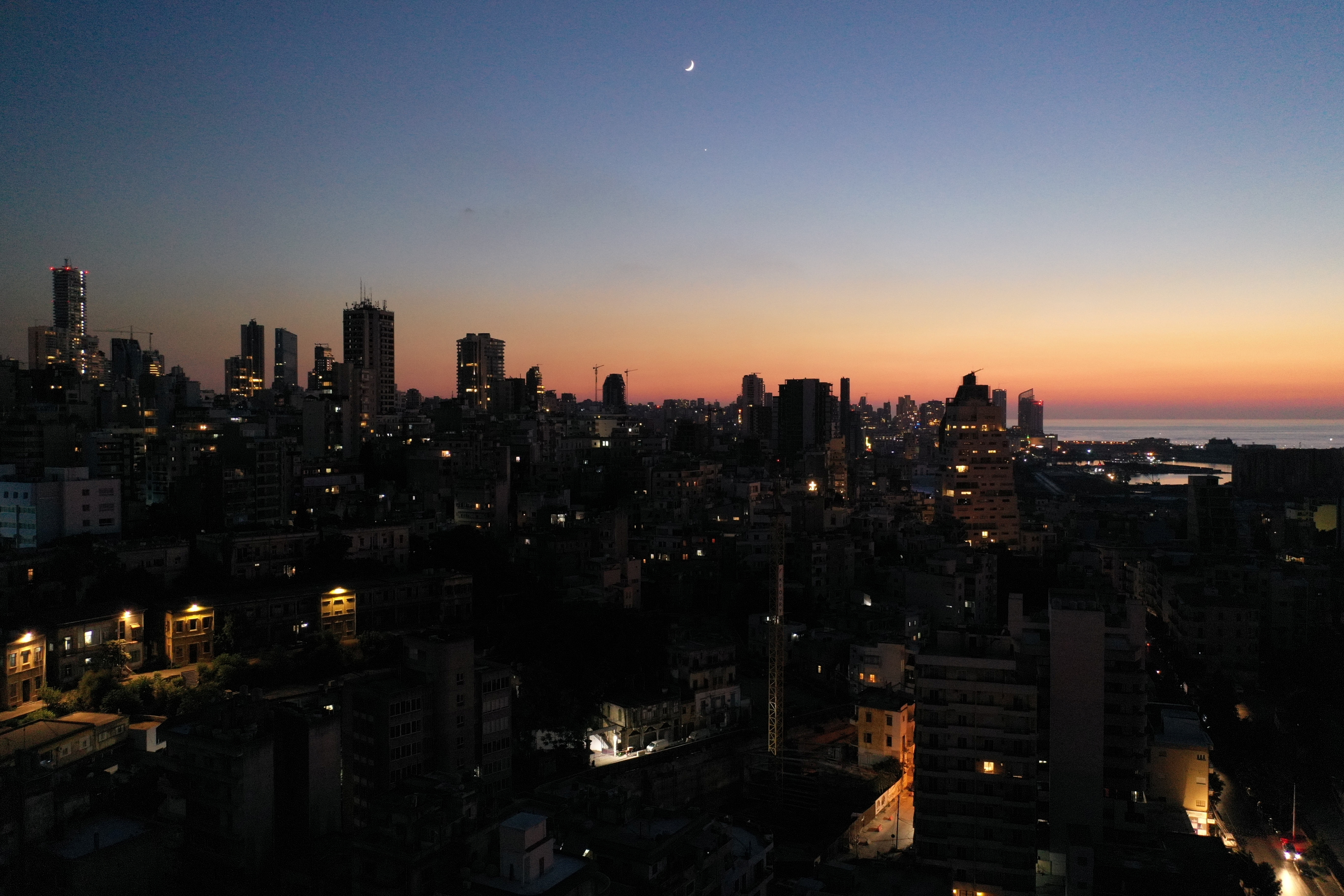 Unlit buildings are seen during a partial blackout in Beirut, Lebanon August 11, 2021.REUTERS/Issam Abdallah