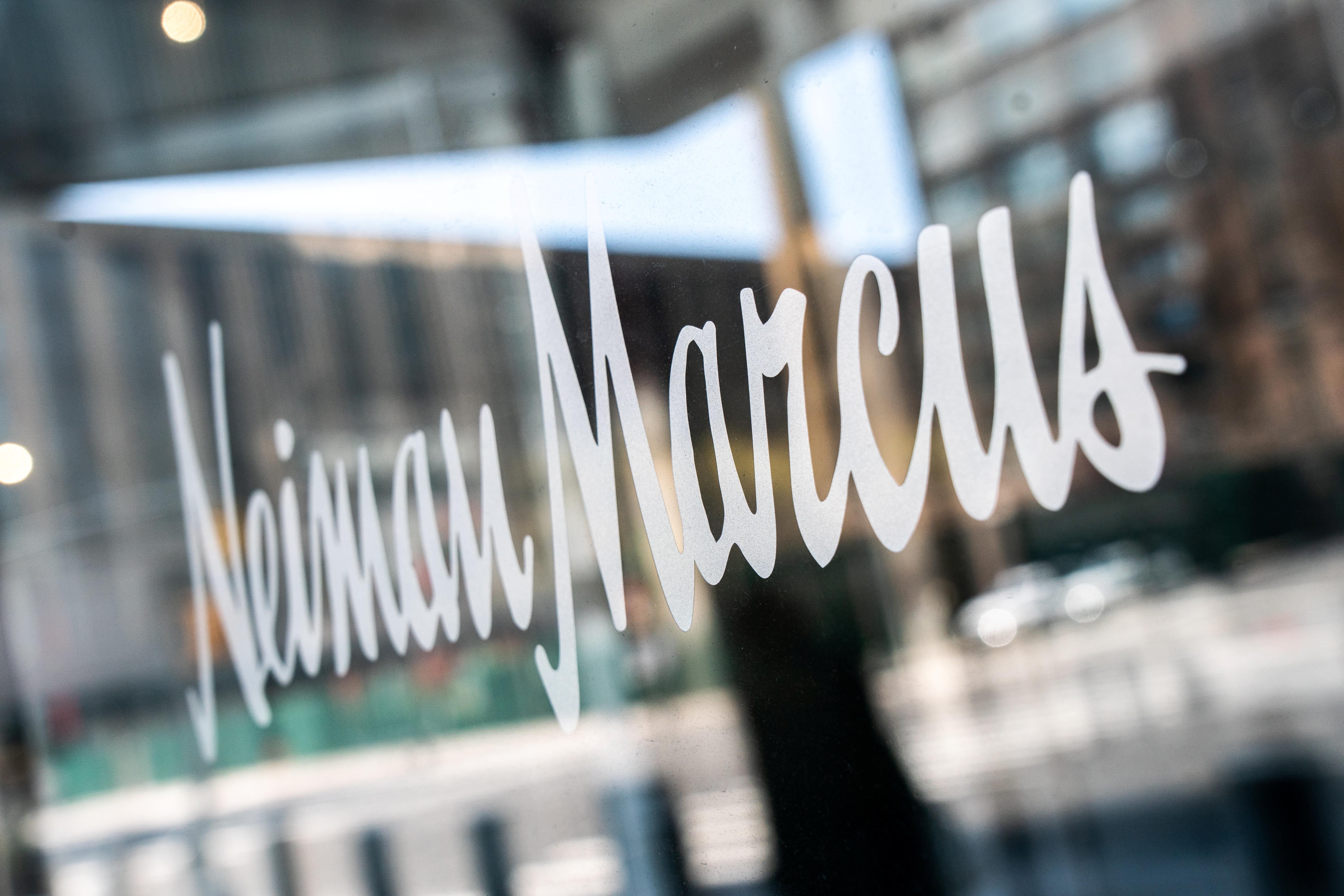 File photo: The signage outside the Neiman Marcus store is seen during the outbreak of the coronavirus disease (COVID-19) in New York City, U.S., April 19, 2020. REUTERS/Jeenah Moon