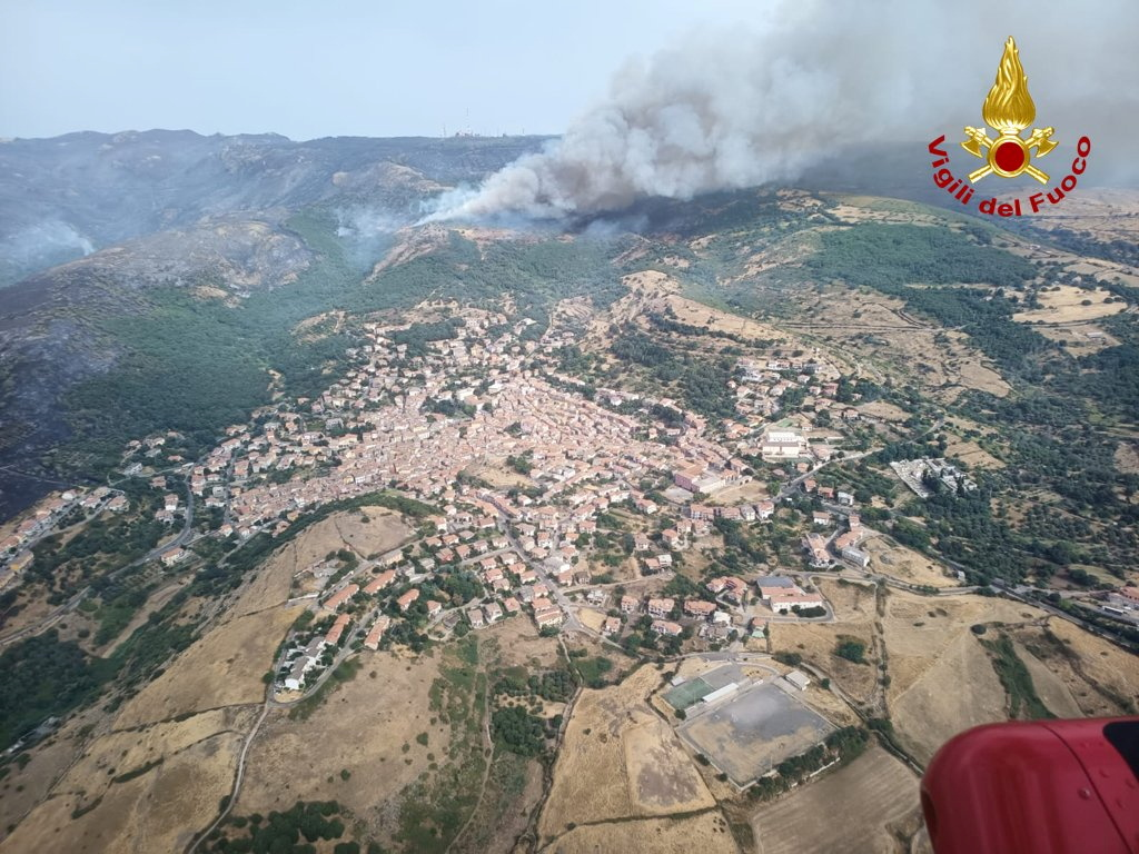 An aerial view from a helicopter shows a large wildfire that broke out near Santu Lussurgiu, Sardinia, Italy July 25, 2021. Vigili del Fuoco/Handout via REUTERS ATTENTION EDITORS THIS IMAGE HAS BEEN SUPPLIED BY A THIRD PARTY. DO NOT OBSCURE LOGO.