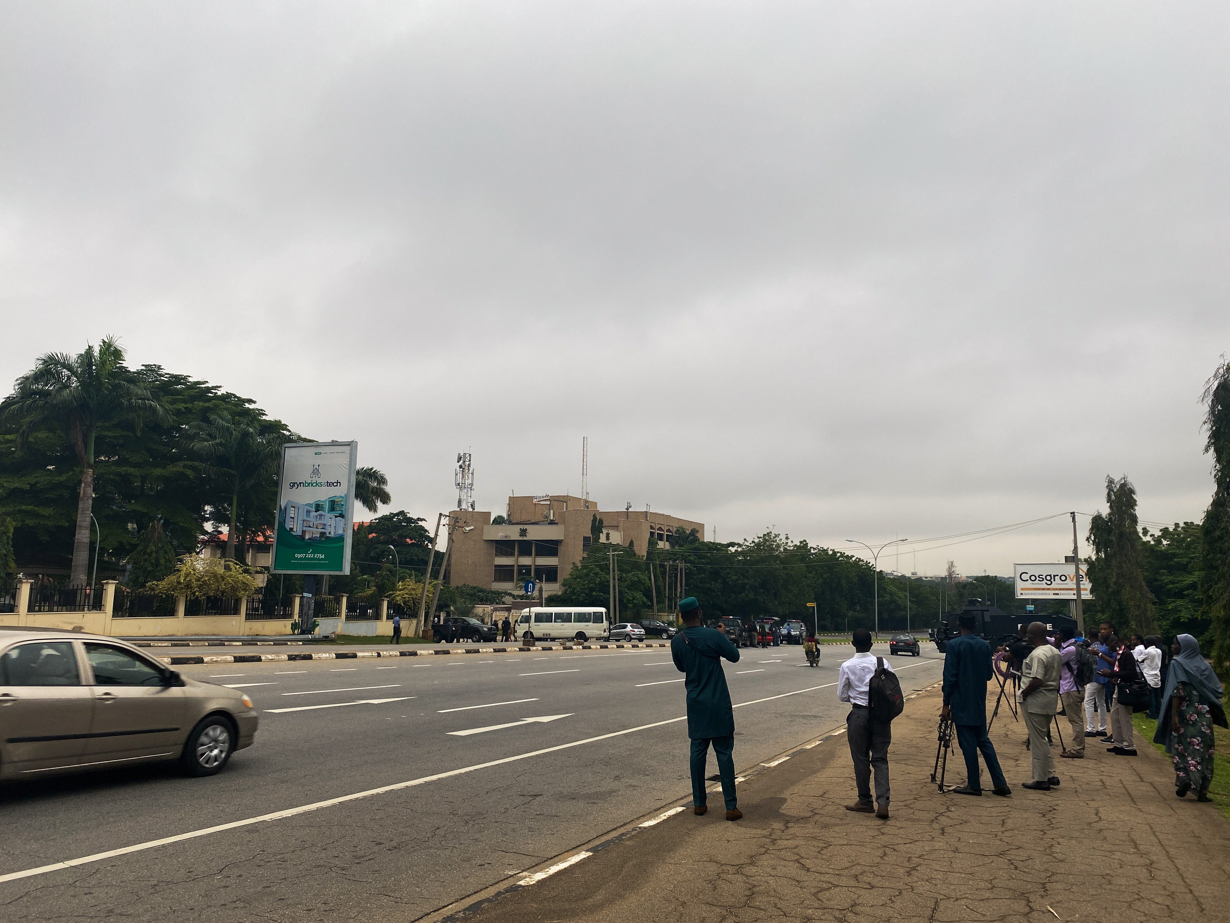 Journalists are seen stationed outside the Federal High Court as they await the arrival of IPOB leader Nnamdi Kanu at the court in Abuja, Nigeria. July 26, 2021. REUTERS/Abraham Achirga