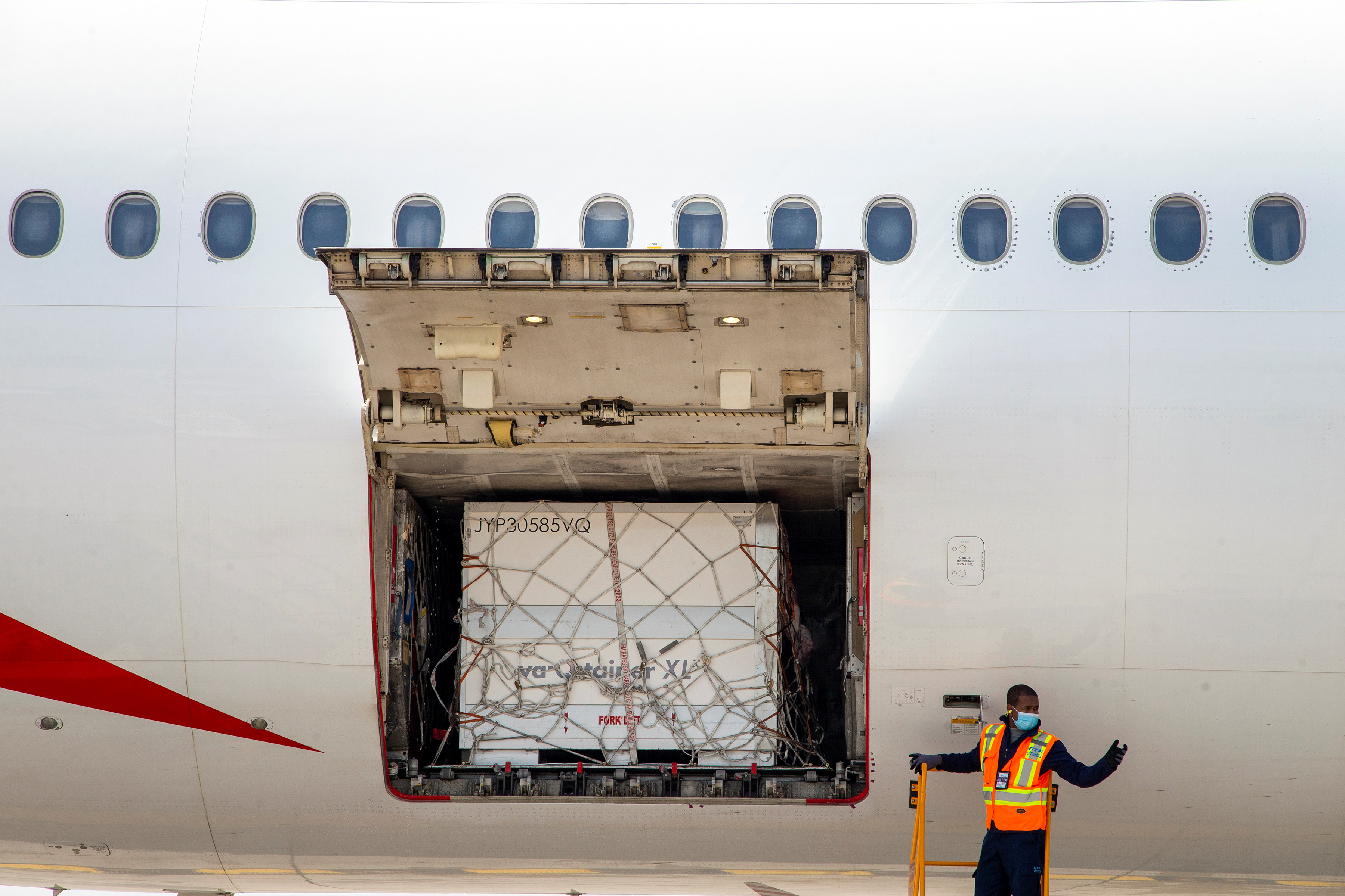 Ground crew unload a shipment from South Africa of the Johnson & Johnson vaccine against the coronavirus disease (COVID-19) at Toronto Pearson Airport in Mississauga, Ontario, Canada April 28, 2021. REUTERS/Carlos Osorio