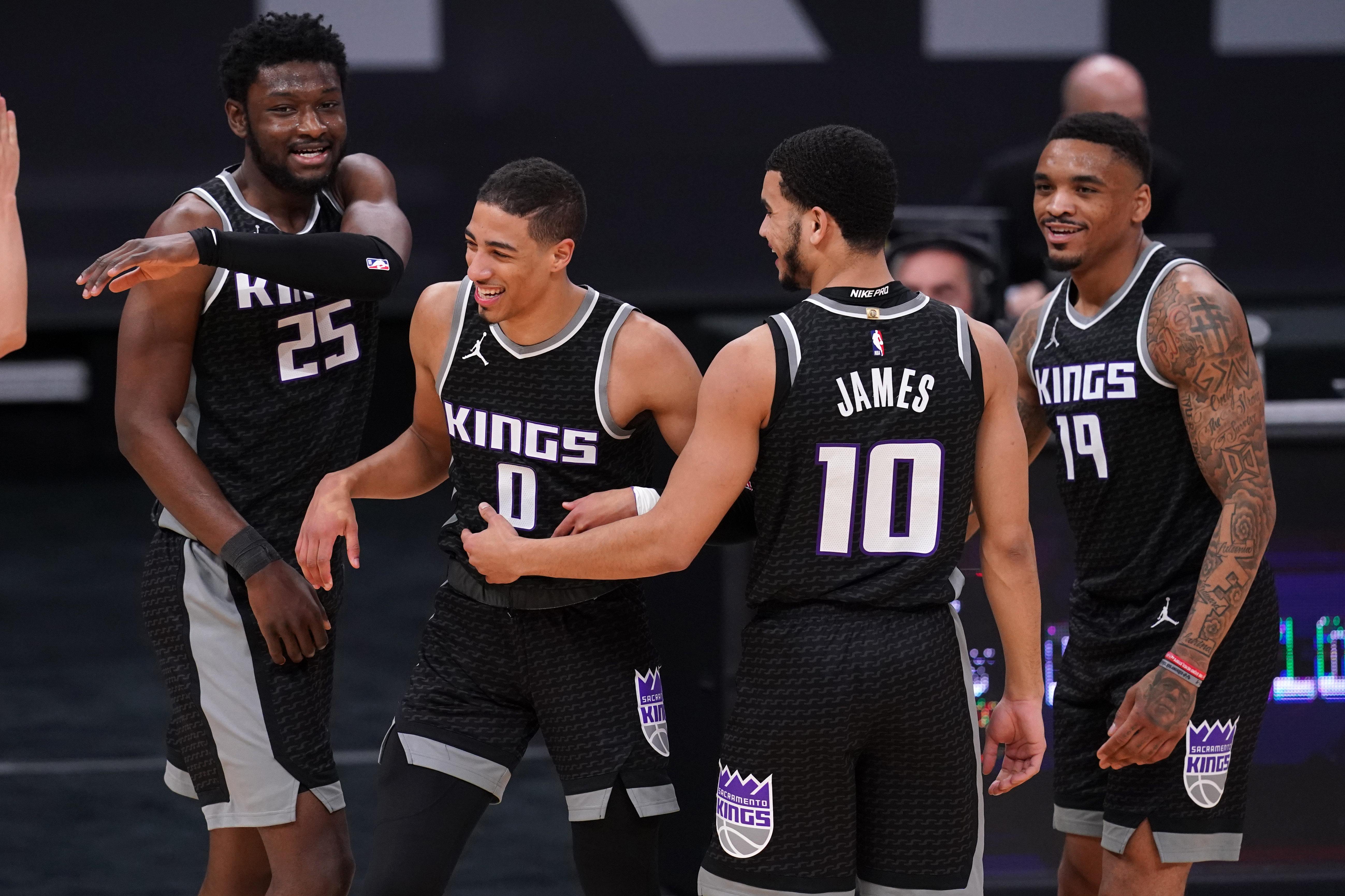 Mar 25, 2021; Sacramento, California, USA; Sacramento Kings guard Tyrese Haliburton (0) is congratulated by teammates after making a three point basket while being fouled against the Golden State Warriors in the third quarter at the Golden 1 Center. Mandatory Credit: Cary Edmondson-USA TODAY Sports