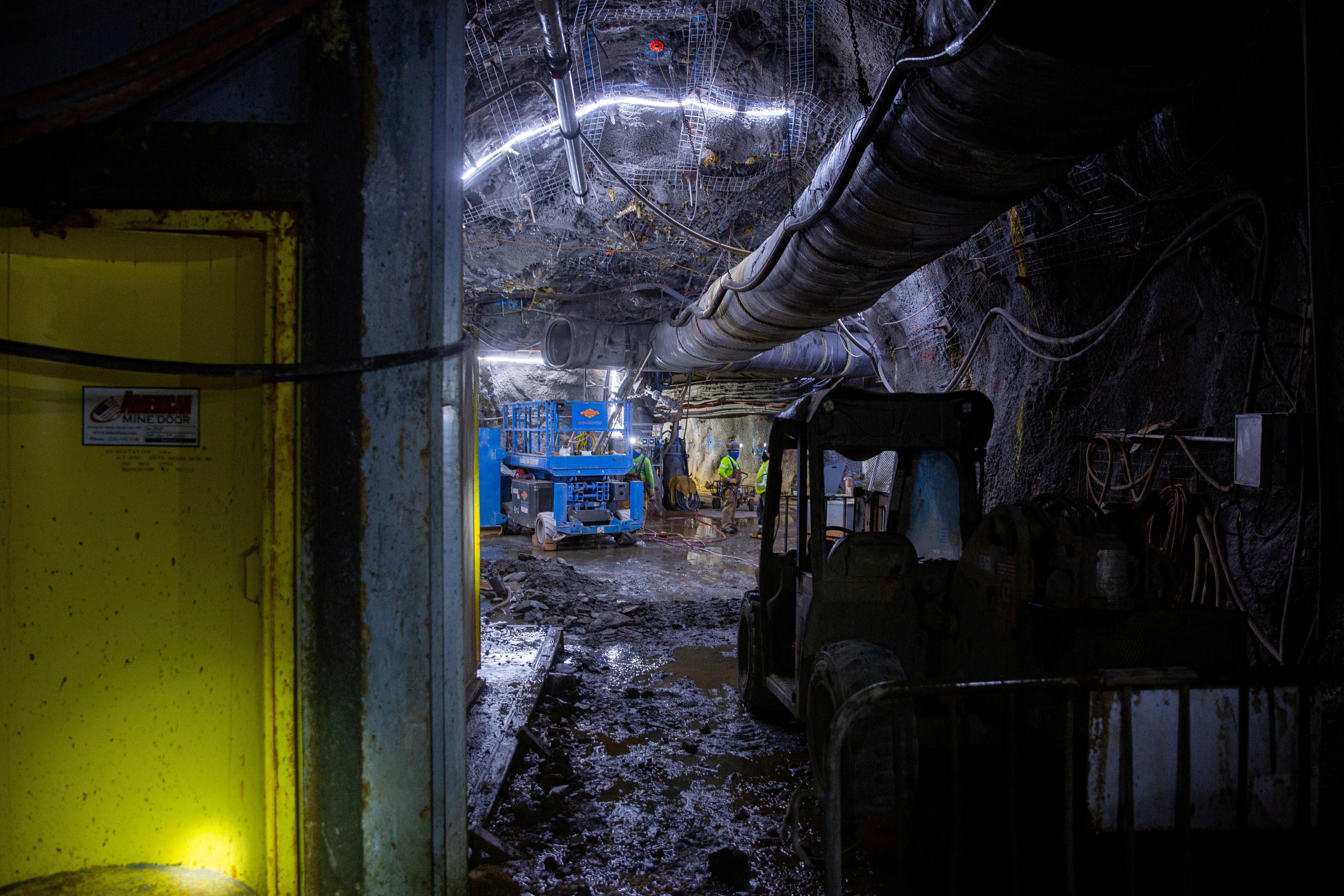 Mine workers Matthew Berumen, Chris Allison and Ray Ramirez do maintenance work 6780 ft (2066 m) underground in the Resolution Copper exploratory mine shaft 10 in Superior, Arizona, U.S., March 30, 2021.  REUTERS/Caitlin O'Hara/File Photo