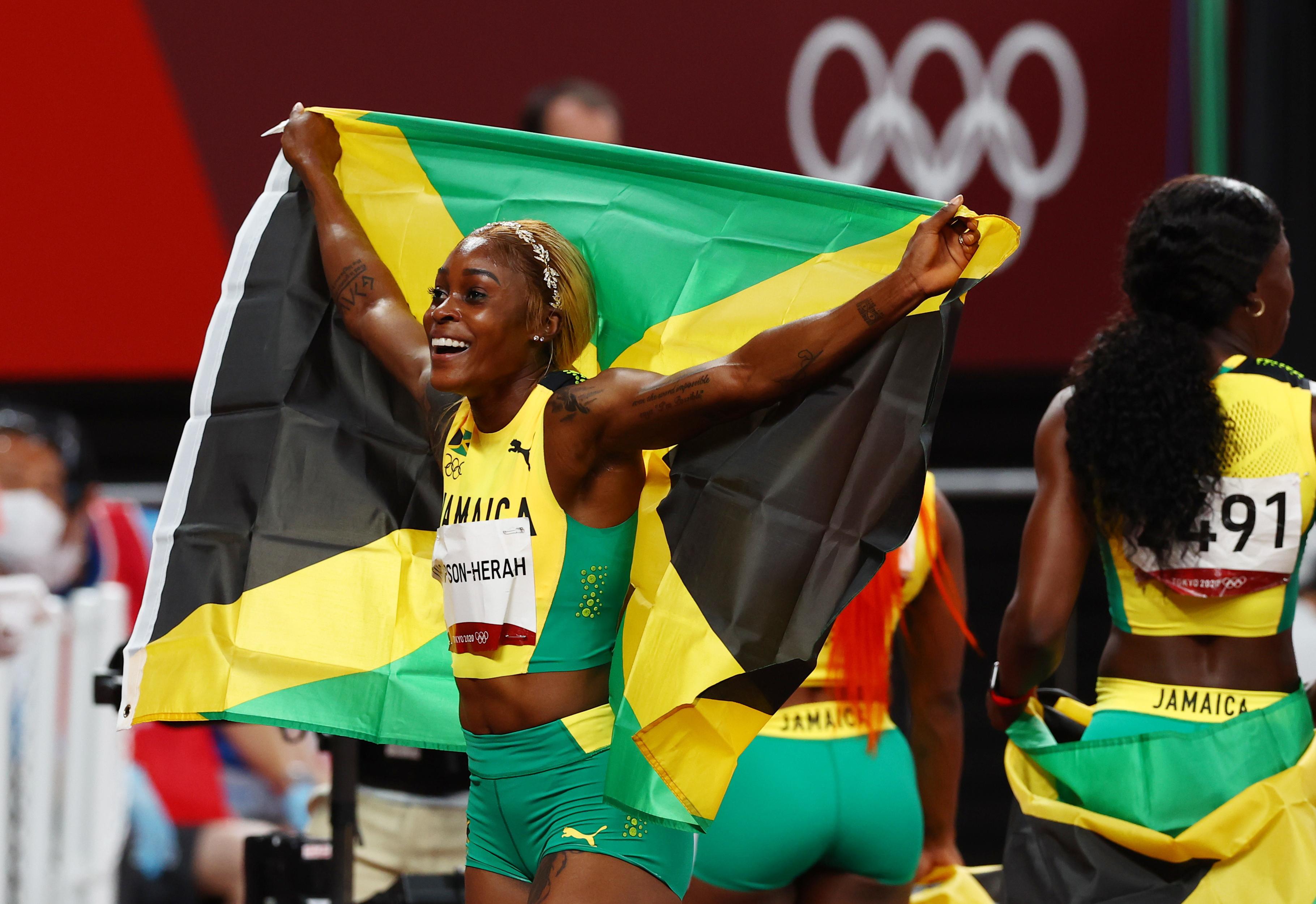 Tokyo 2020 Olympics - Athletics - Women's 100m - Final - OLS - Olympic Stadium, Tokyo, Japan - July 31, 2021. Elaine Thompson-Herah of Jamaica celebrates winning the gold medal REUTERS/Kai Pfaffenbach