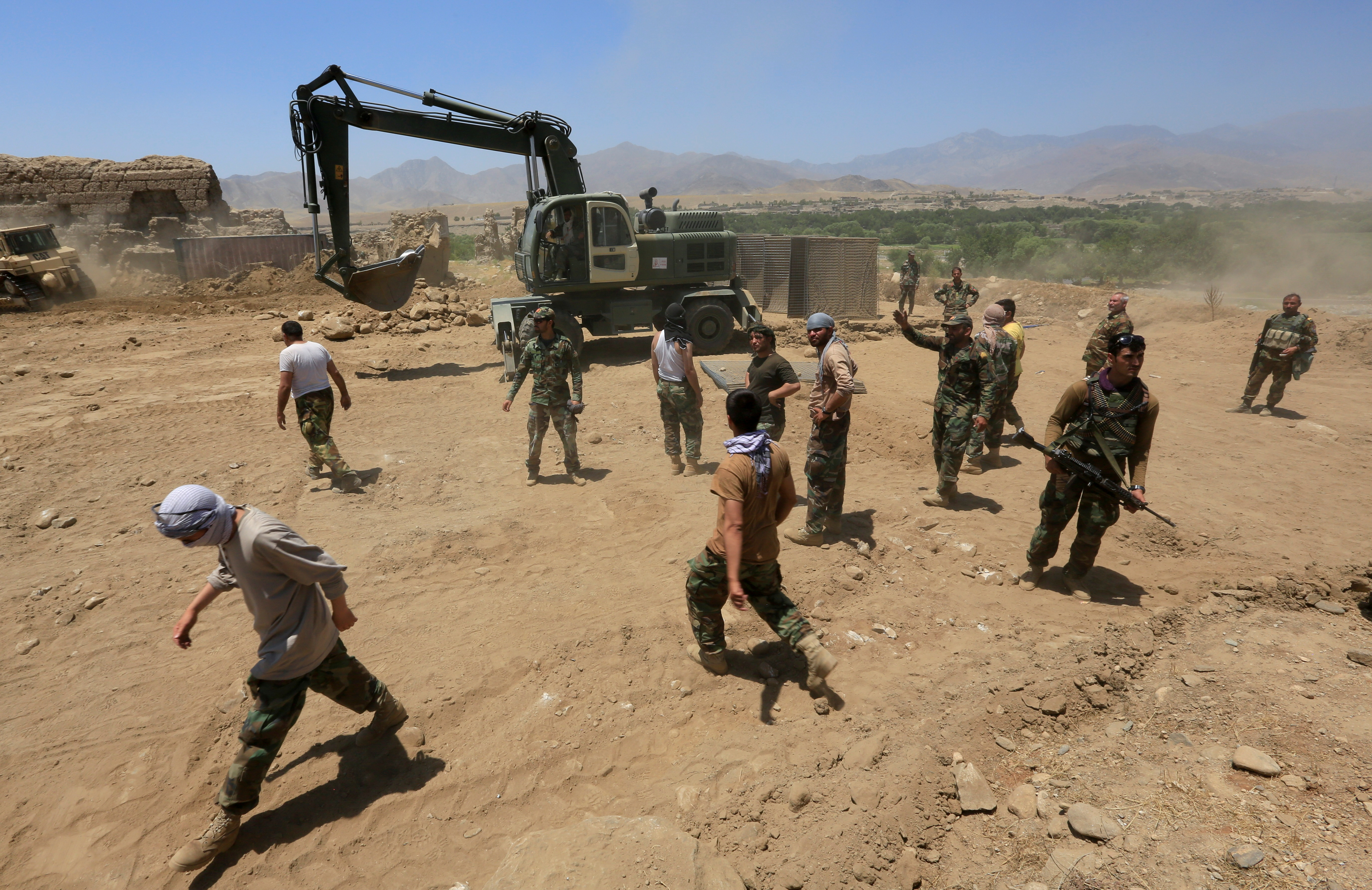 Afghan National Army (ANA) soldiers rebuild a checkpoint recaptured from the Taliban, in the Alishing district of Laghman province, Afghanistan July 8, 2021. REUTERS/Parwiz