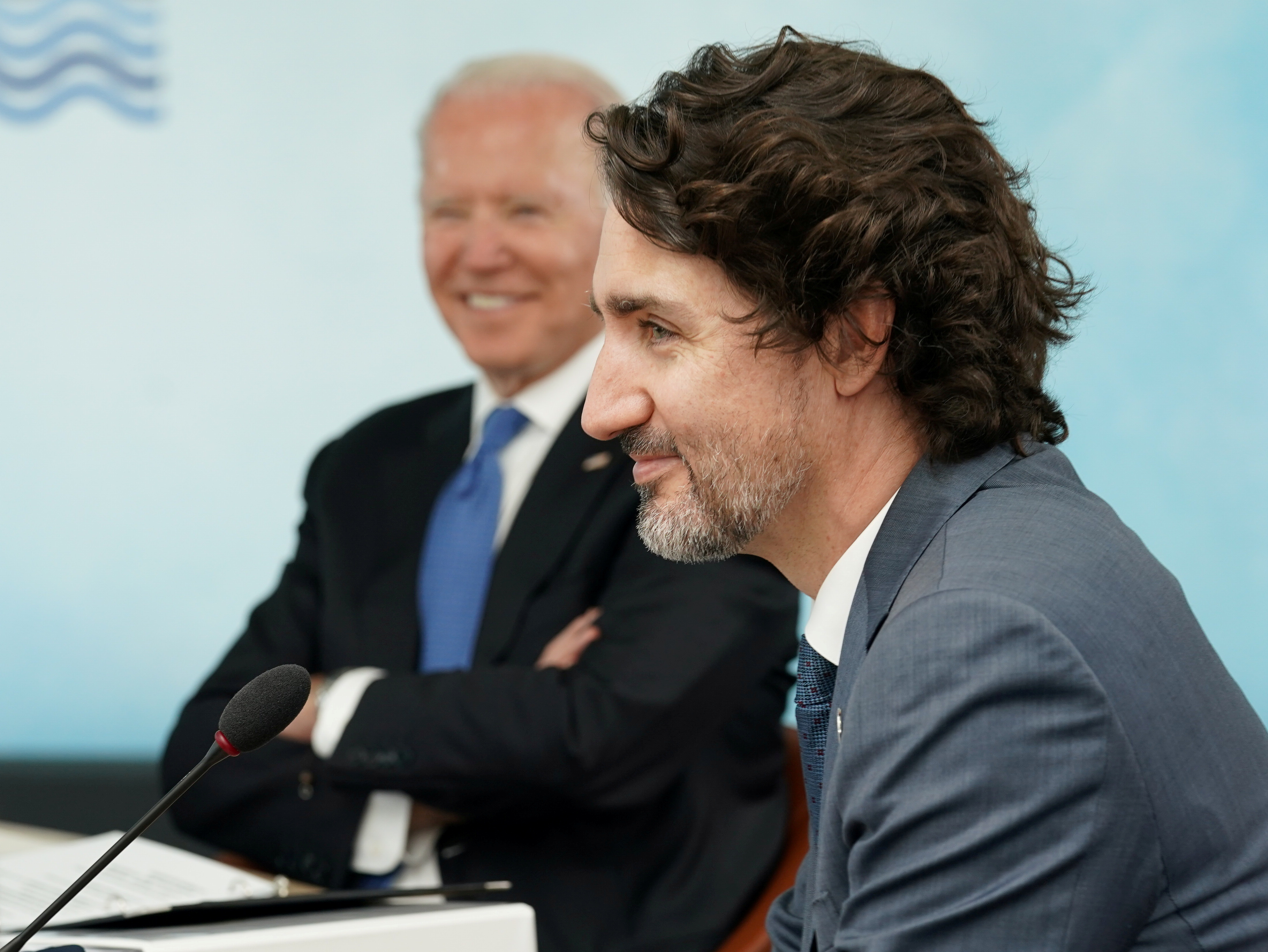 U.S. President Joe Biden and Canada's Prime Minister Justin Trudeau attend a session during the G7 summit in Carbis Bay, Cornwall, Britain, June 11, 2021. REUTERS/Kevin Lamarque/Pool/File Photo