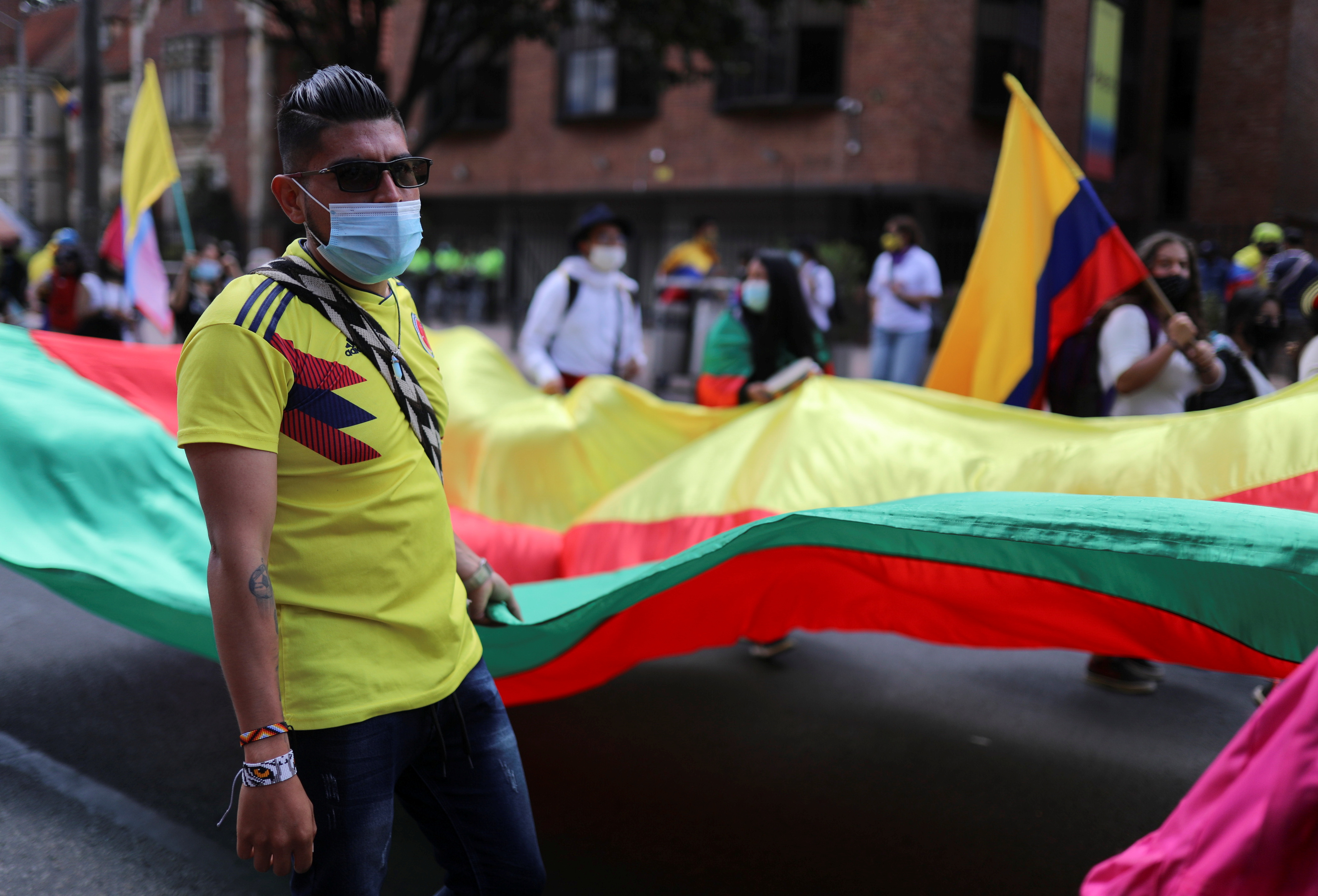 Demonstrators take part in a protest demanding government action to tackle poverty, police violence and inequalities in healthcare and education systems, in Bogota, Colombia, May 19, 2021. REUTERS/Luisa Gonzalez