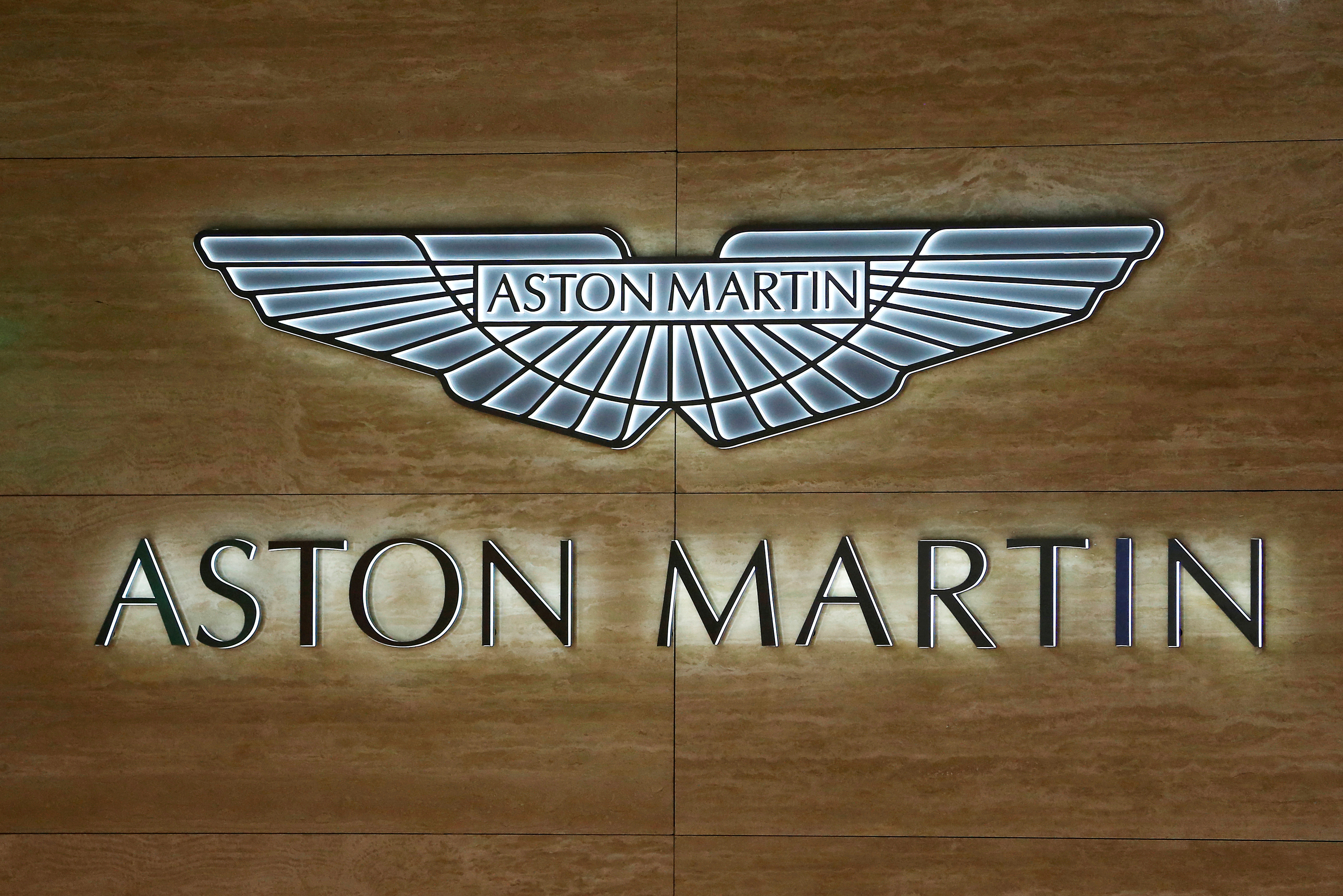 An Aston Martin logo is displayed at the 89th Geneva International Motor Show in Geneva, Switzerland March 5, 2019.  REUTERS/Pierre Albouy/File Photo