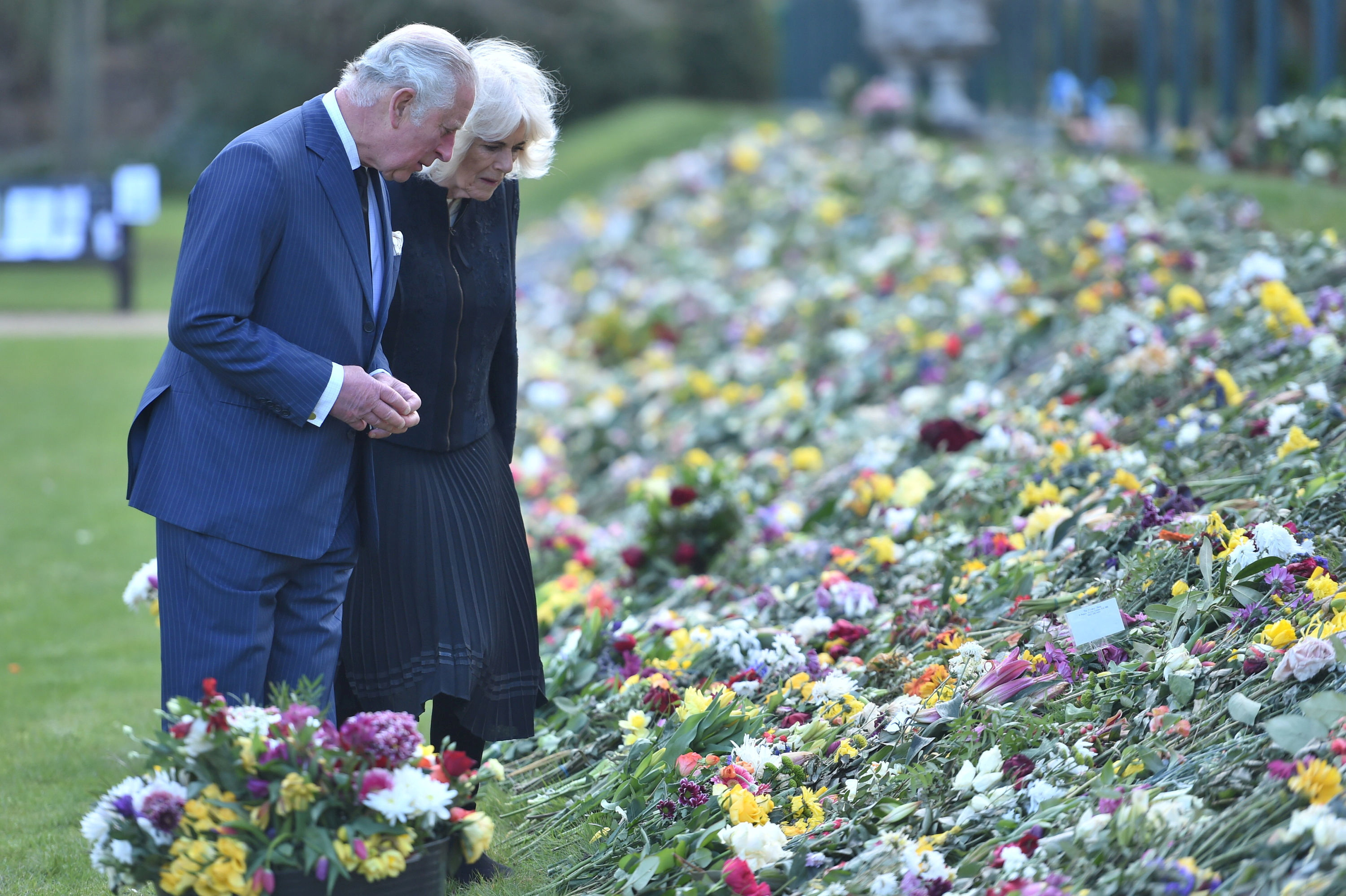 Britain's Prince Charles and Camilla, Duchess of Cornwall, visit the gardens of Marlborough House to view the flowers and messages left by members of the public outside Buckingham Palace following the death of Britain's Prince Philip, in London, Britain April 15, 2021. Jeremy Selwyn/Pool via REUTERS