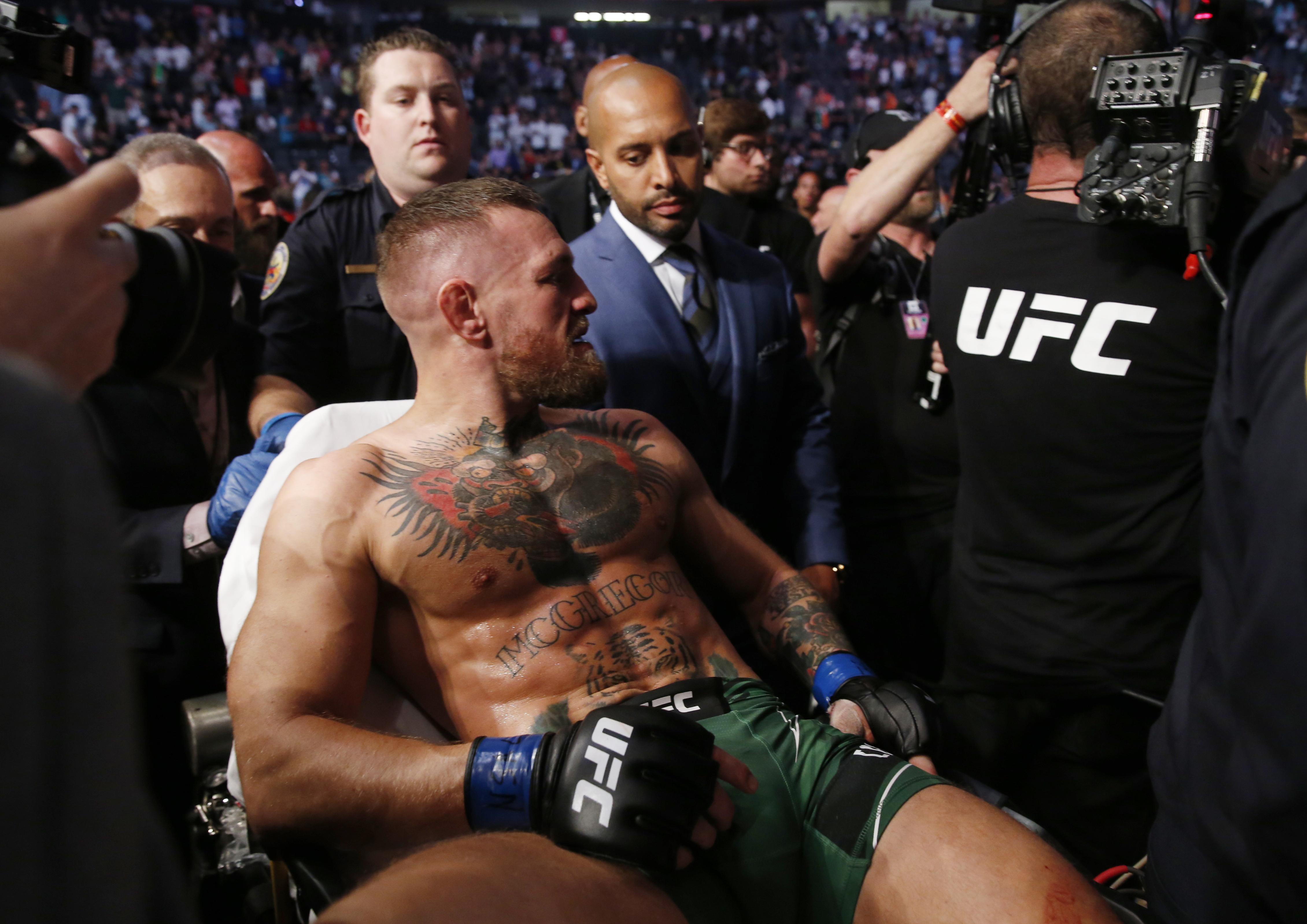 McGregor breaks leg in latest UFC loss to Dustin Poirier | Reuters