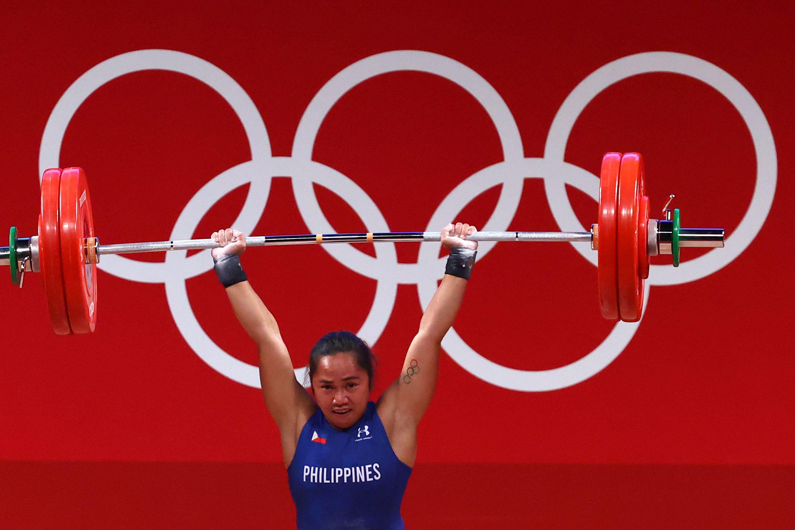 Tokyo 2020 Olympics - Weightlifting - Women's 55kg - Group A - Tokyo International Forum, Tokyo, Japan - July 26, 2021. Hidilyn Diaz of the Philippines in action. REUTERS/Edgard Garrido