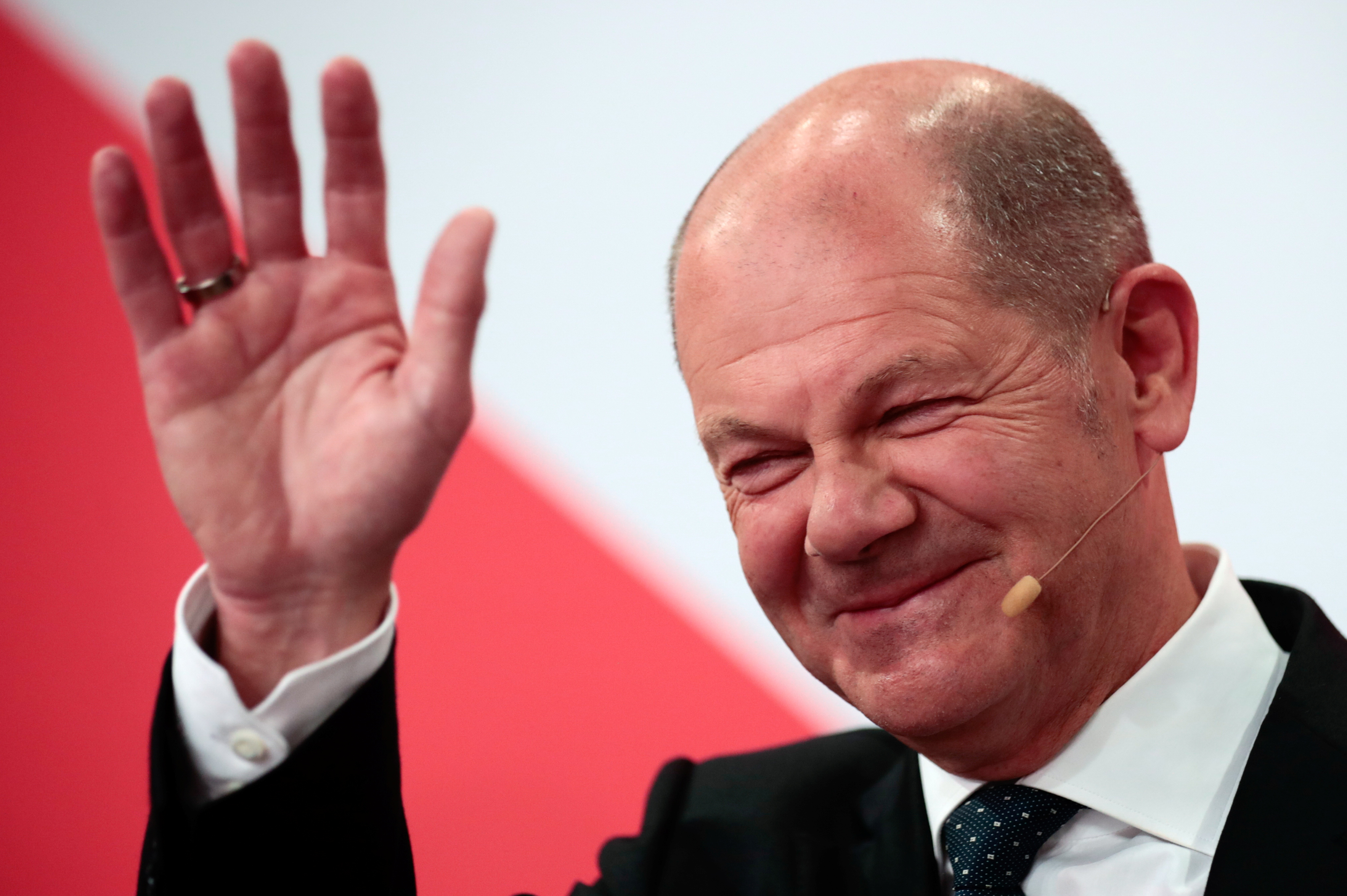 Social Democratic Party (SPD) leader and top candidate for chancellor Olaf Scholz waves after first exit polls for the general elections in Berlin, Germany, September 26, 2021.    REUTERS/Hannibal Hanschke
