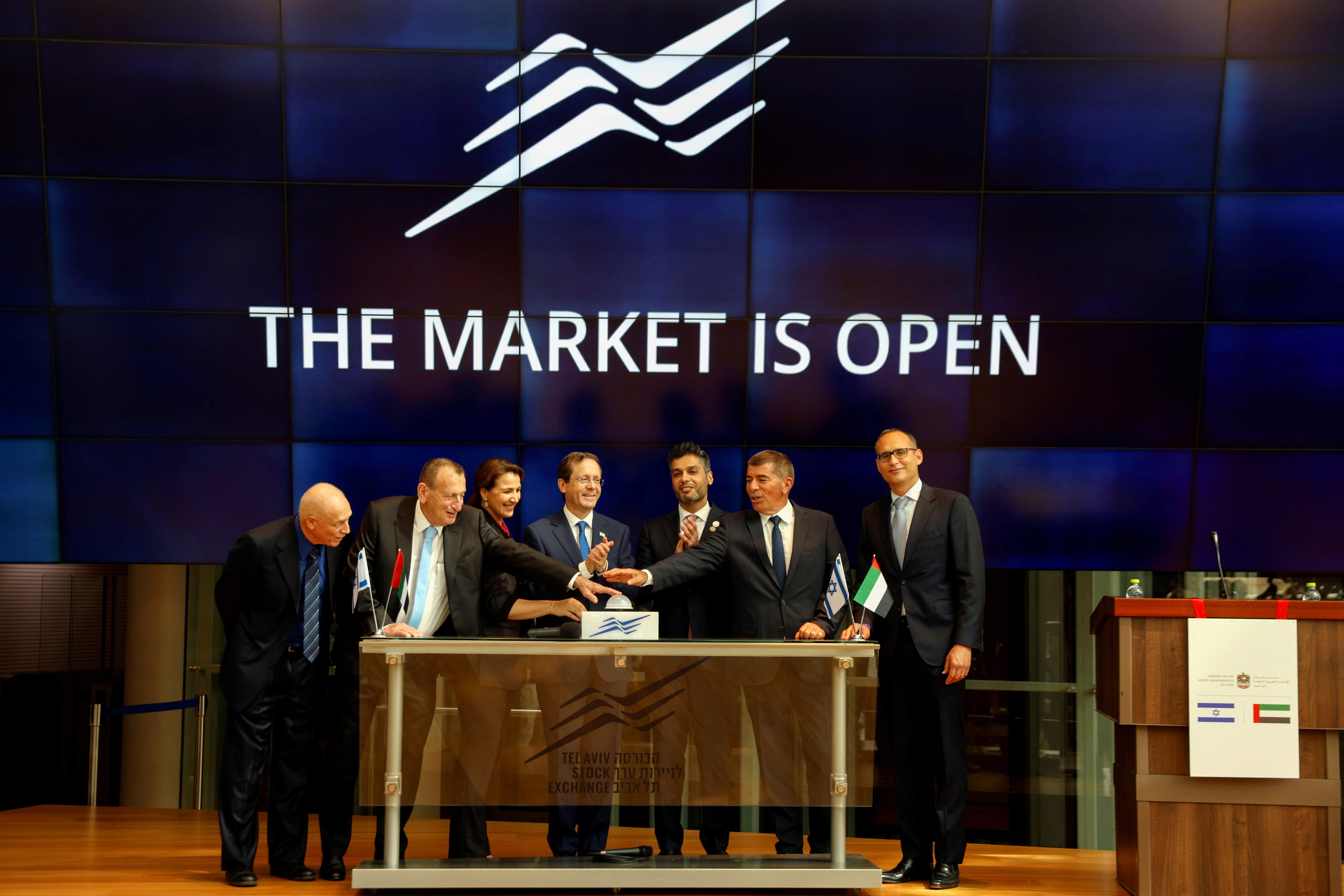 UAE Ambassador to Israel, Mohamed Al Khaja, and Israeli President Isaac Herzog clap as other officials press a button to start the stock exchange market during the opening ceremony of the Emirati embassy in Tel Aviv, Israel July 14, 2021. REUTERS/Amir Cohen/File Photo
