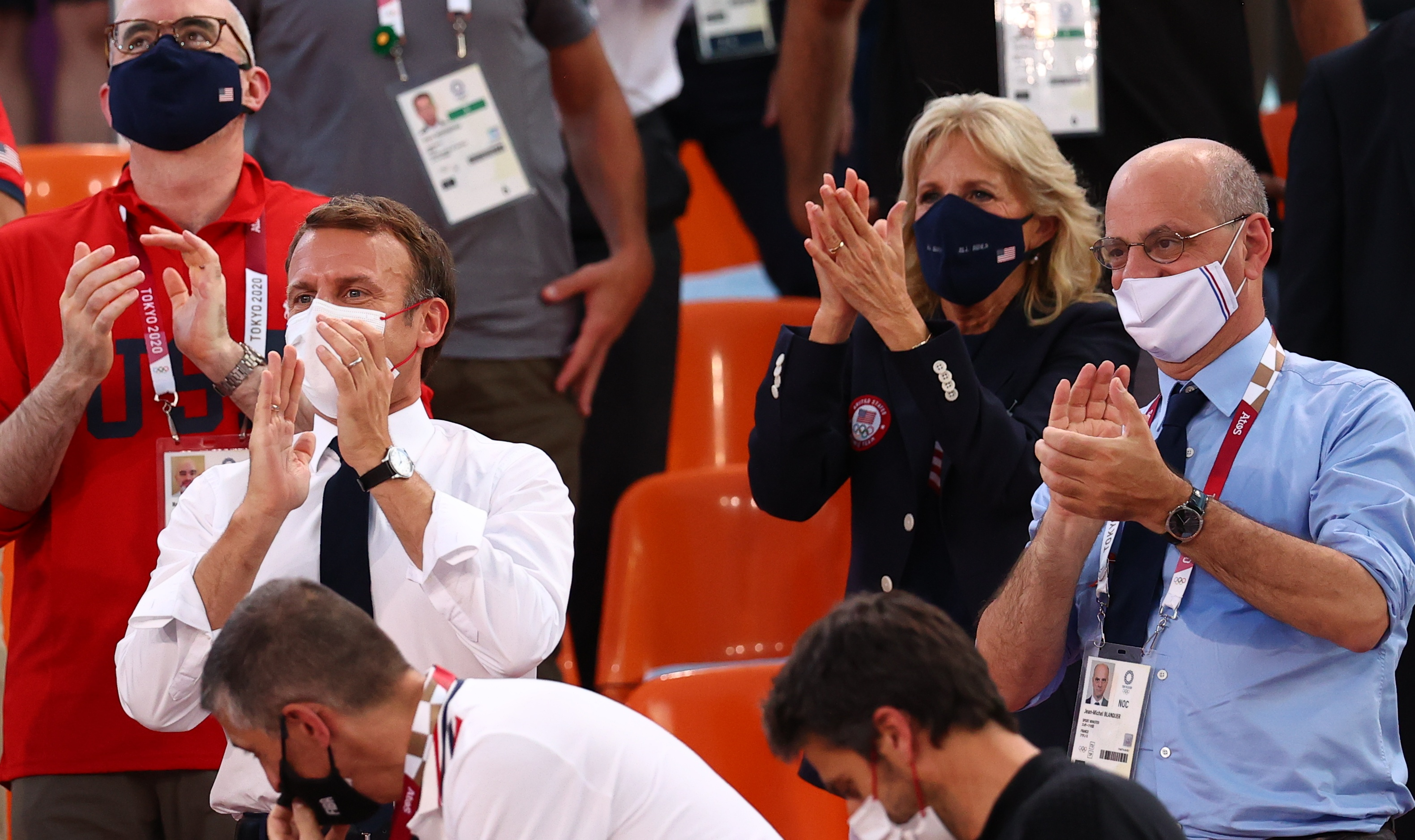 Tokyo 2020 Olympics - Basketball 3x3 - Women - Pool A - United States v France - Aomi Urban Sports Park, Tokyo, Japan - July 24, 2021. France president Emmanuel Macron and U.S. First Lady Jill Biden applaud as they attend the match. REUTERS/Andrew Boyers