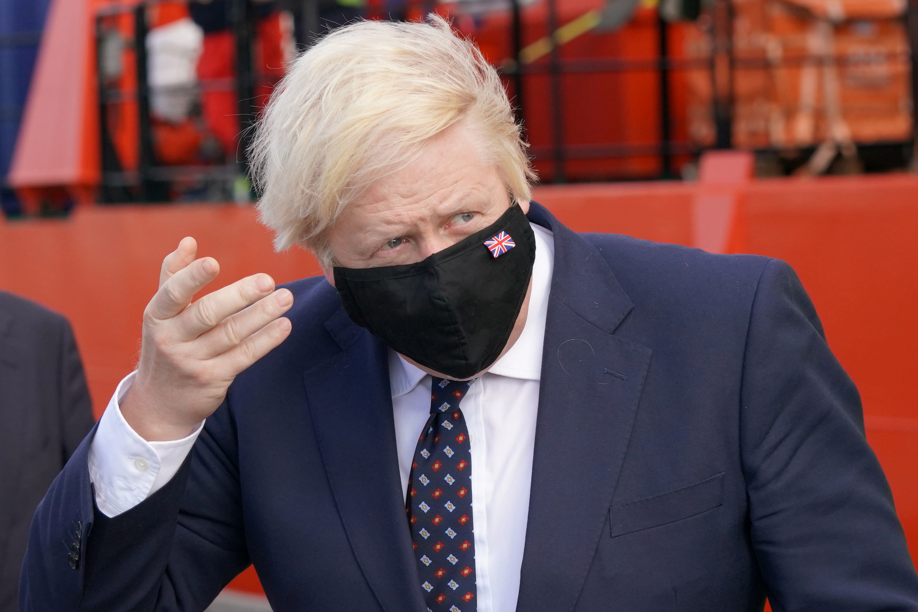 Britain's Prime Minister Boris Johnson gestures before boarding the vessel Alba in Fraserburgh Harbour, which will transport him to the Moray Offshore Windfarm East during his visit to Scotland, Britain August 5, 2021. Jane Barlow/Pool via REUTERS