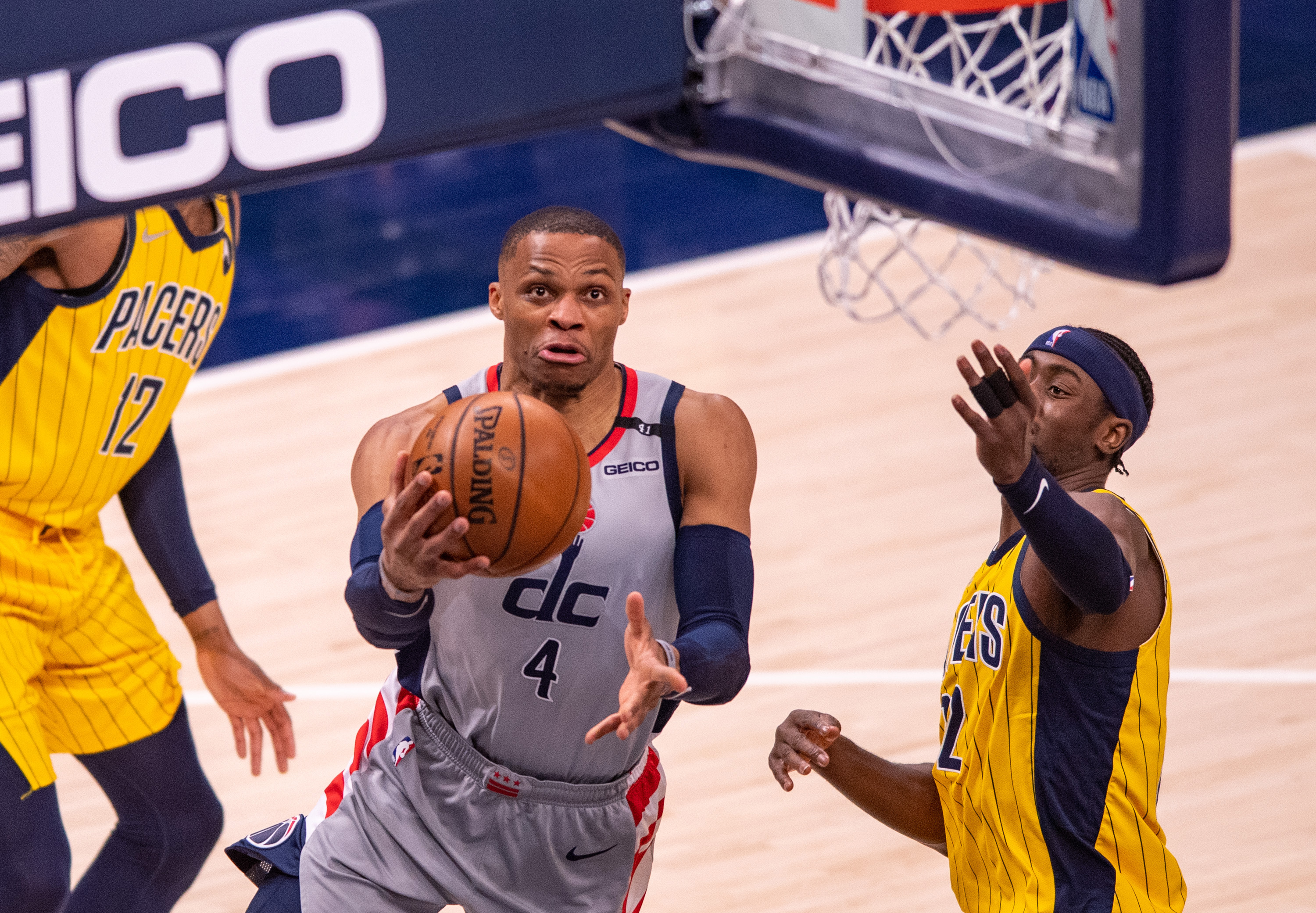 May 8, 2021; Indianapolis, Indiana, USA; Washington Wizards guard Russell Westbrook (4) drives to the basket during the second half of an NBA basketball game against the Indiana Pacers at Bankers Life Fieldhouse. Mandatory Credit: Doug McSchooler-USA TODAY Sports