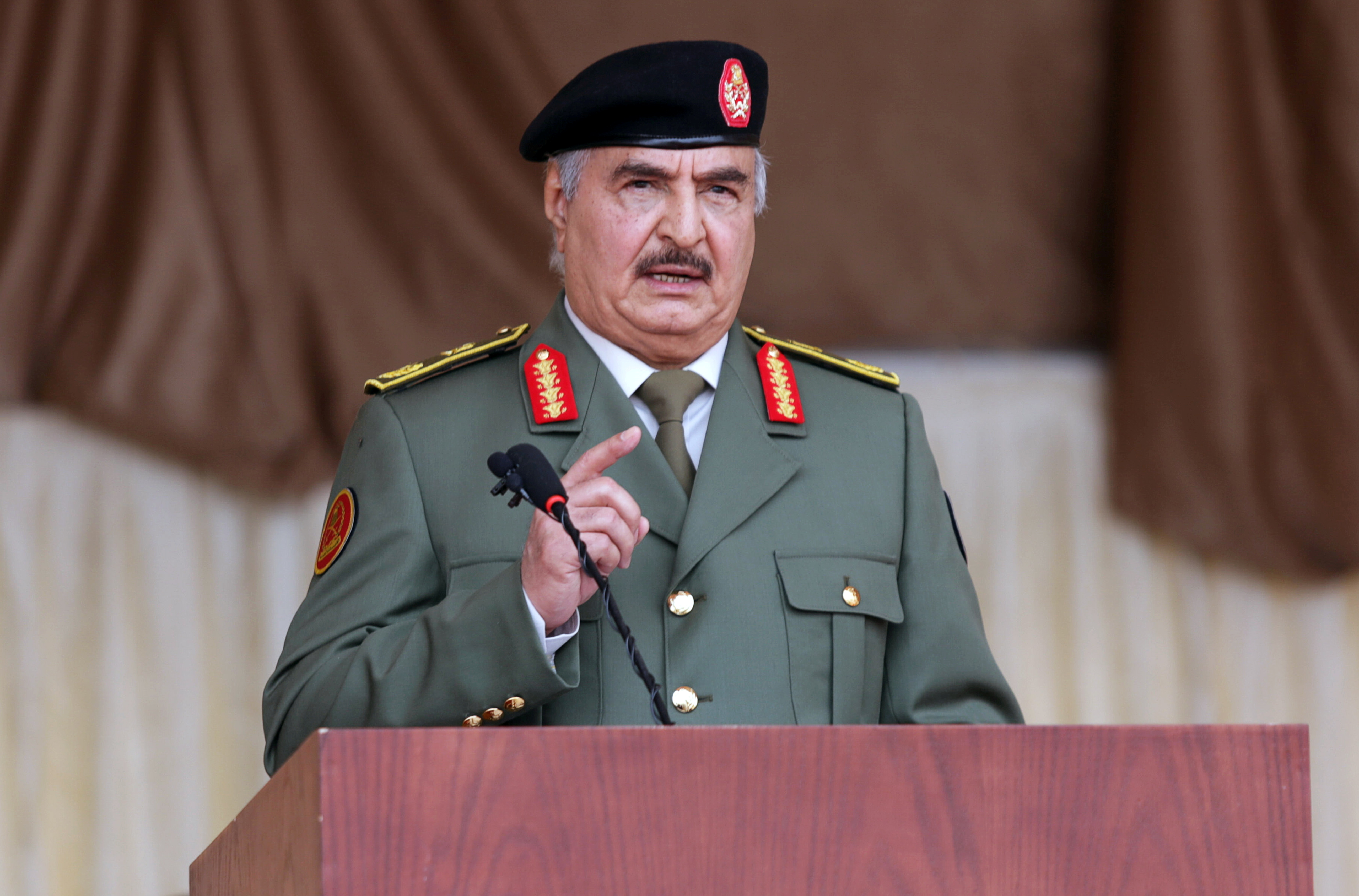 Libyan military commander Khalifa Haftar gestures as he speaks during Independence Day celebrations in Benghazi, Libya December 24, 2020. REUTERS/Esam Omran Al-Fetori/File Photo