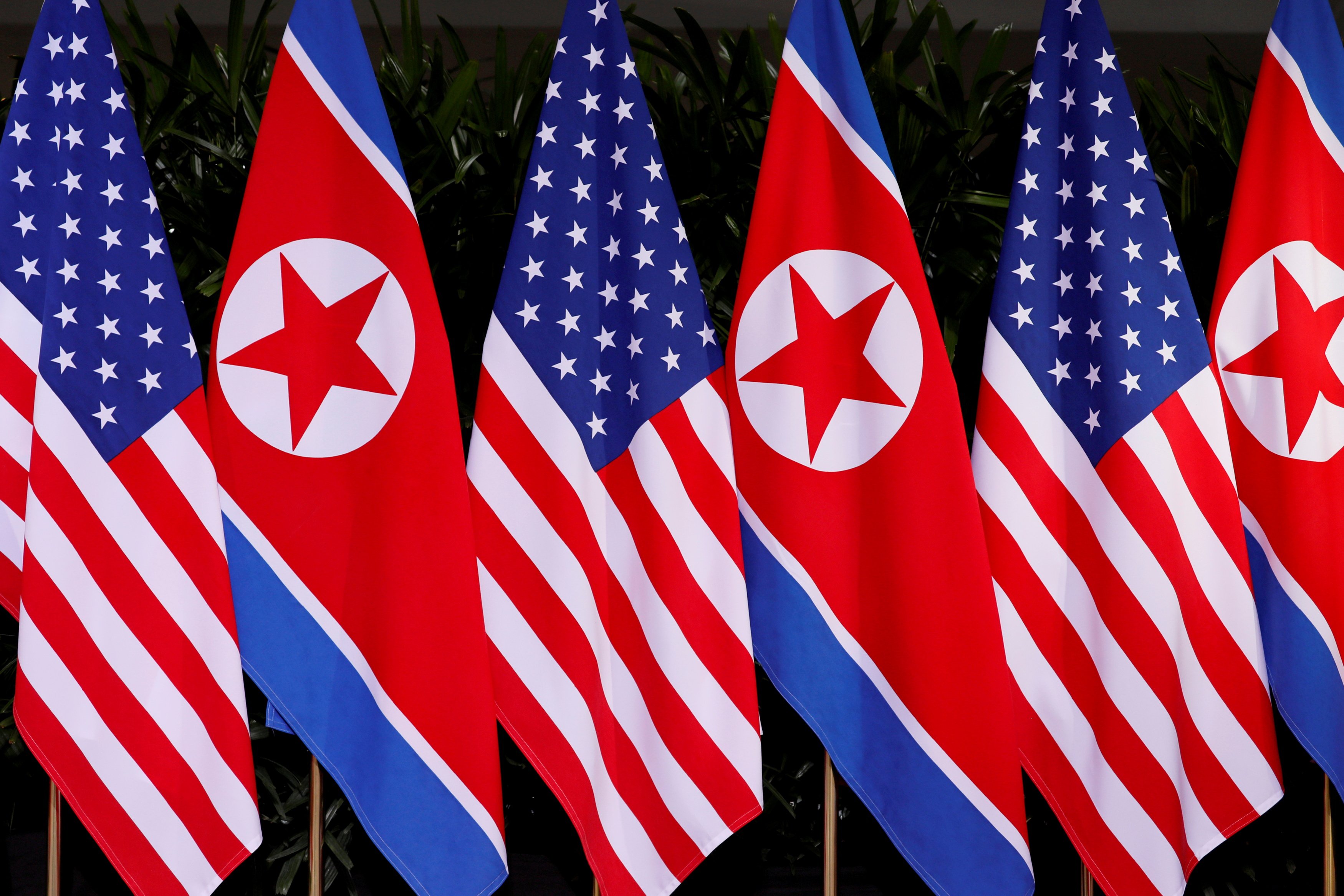 U.S. and North Korean national flags are seen at the Capella Hotel on Sentosa island in Singapore June 12, 2018. REUTERS/Jonathan Ernst