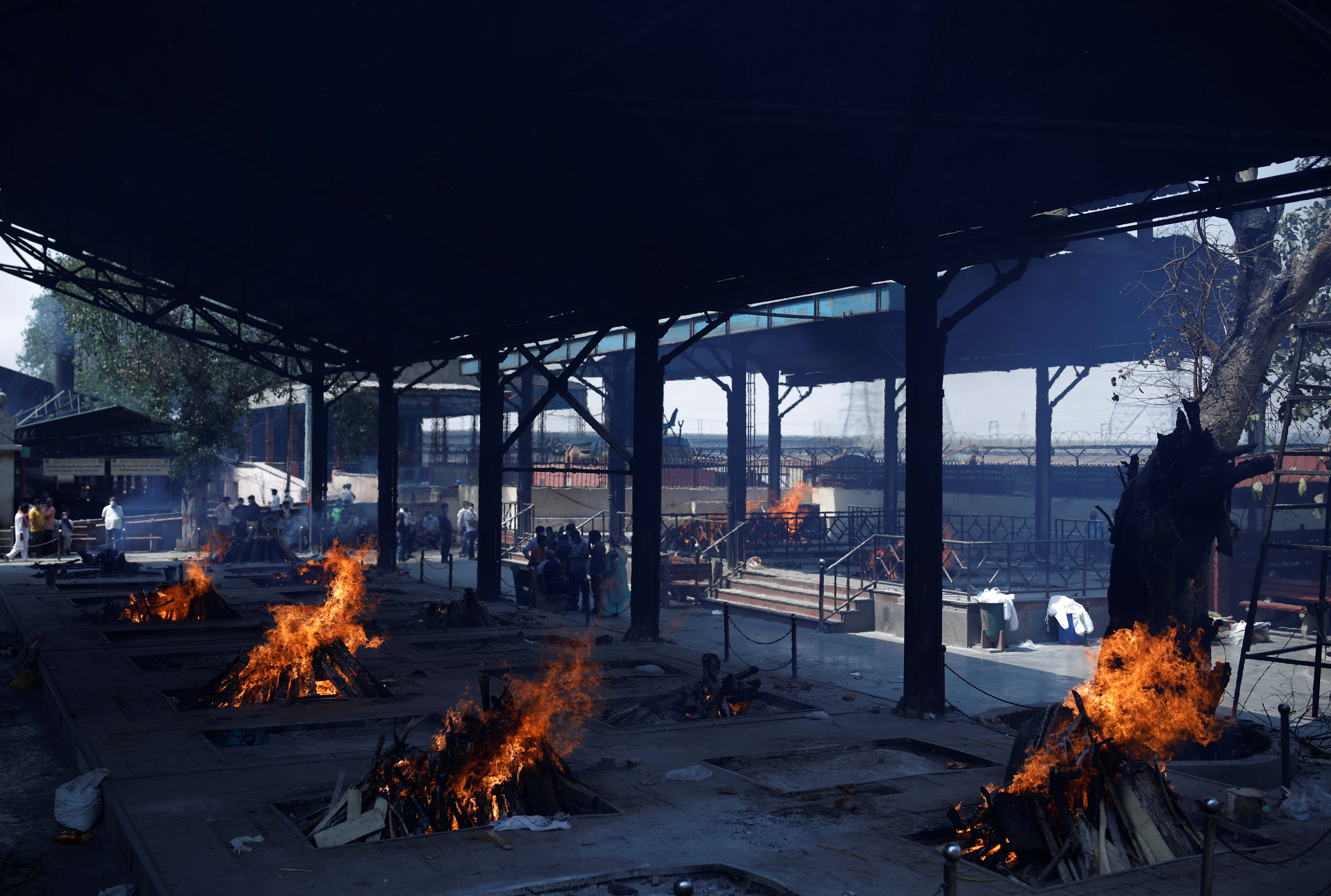 Funeral pyres of people, who died from the coronavirus disease (COVID-19), are pictured at a crematorium in New Delhi, India April 21, 2021. REUTERS/Adnan Abidi