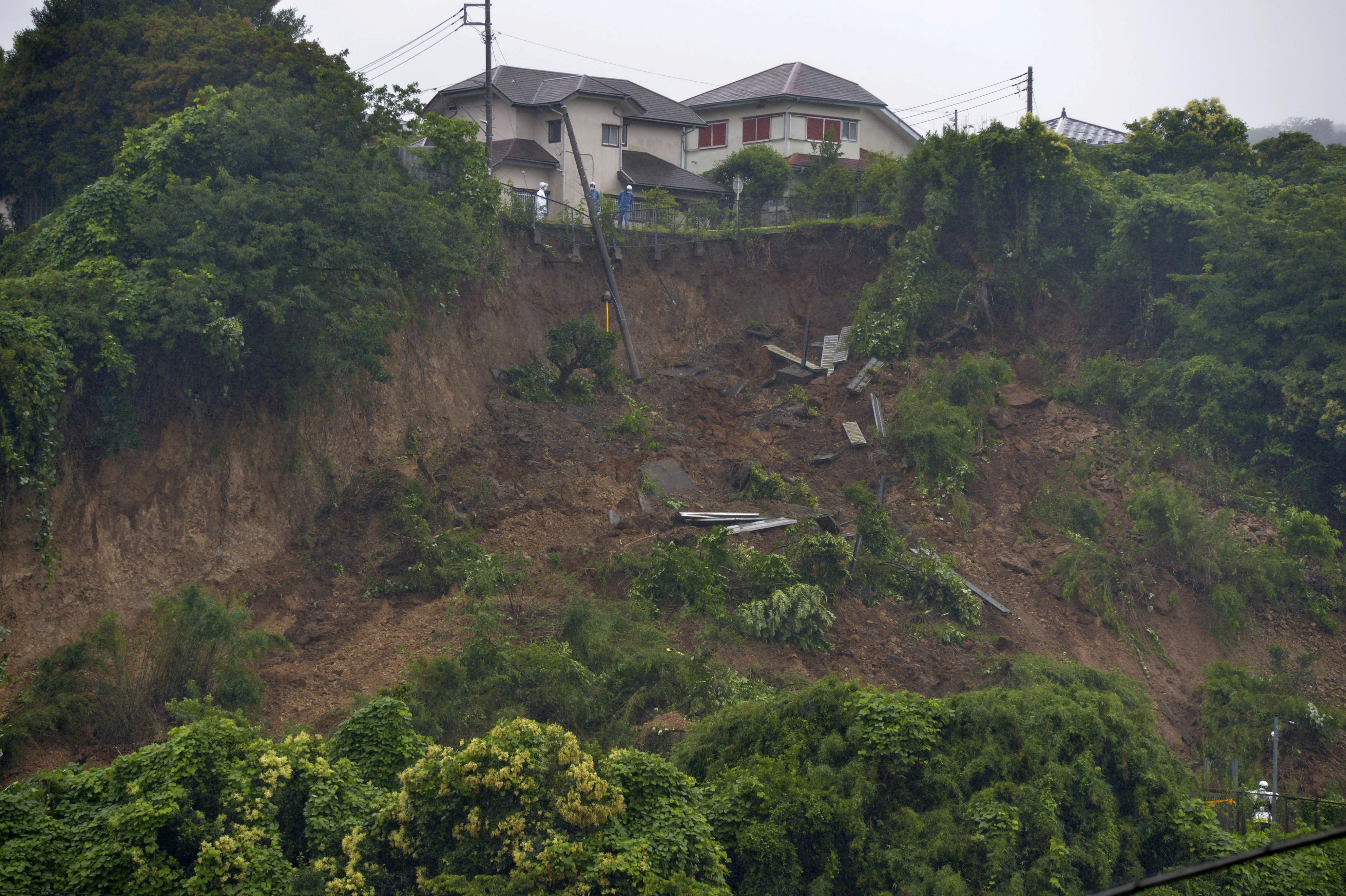 General view of a site where heavy rains triggered a landslide in Zushi, south of Tokyo, Japan July 3, 2021. Kyodo/via REUTERS