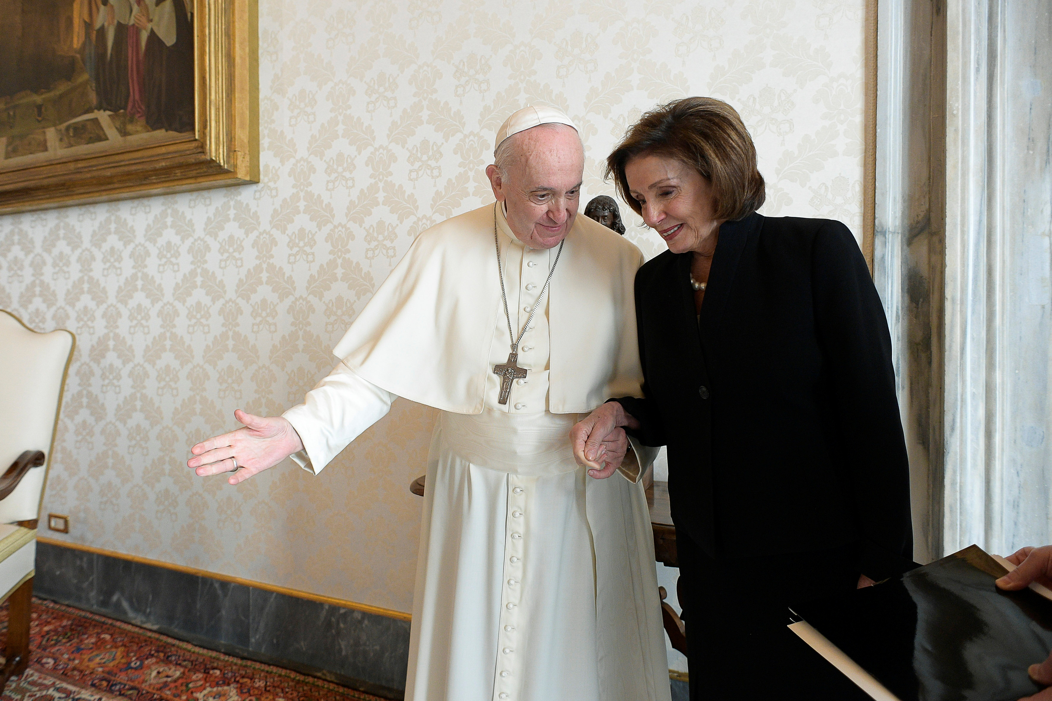 Pope Francis welcomes U.S. Speaker of the House Nancy Pelosi as they meet at the Vatican, October 9, 2021.  Vatican Media/Handout via REUTERS