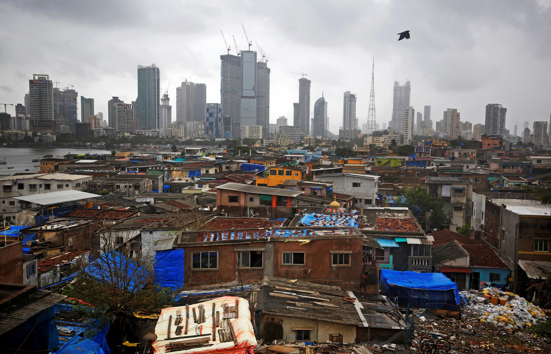 A bird flies across central Mumbai's financial district skyline, India, June 18, 2019. REUTERS/Francis Mascarenhas/File Photo