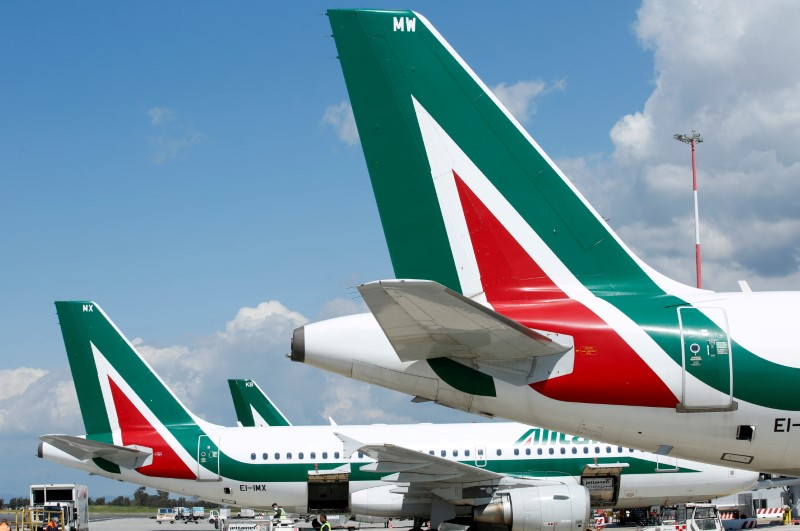 Alitalia planes are seen on the tarmac at Fiumicino International Airport as talks between Italy and the European Commission over the revamp of Alitalia are due to enter a key phase, in Rome, Italy, April 15, 2021. REUTERS/Remo Casilli/File Photo