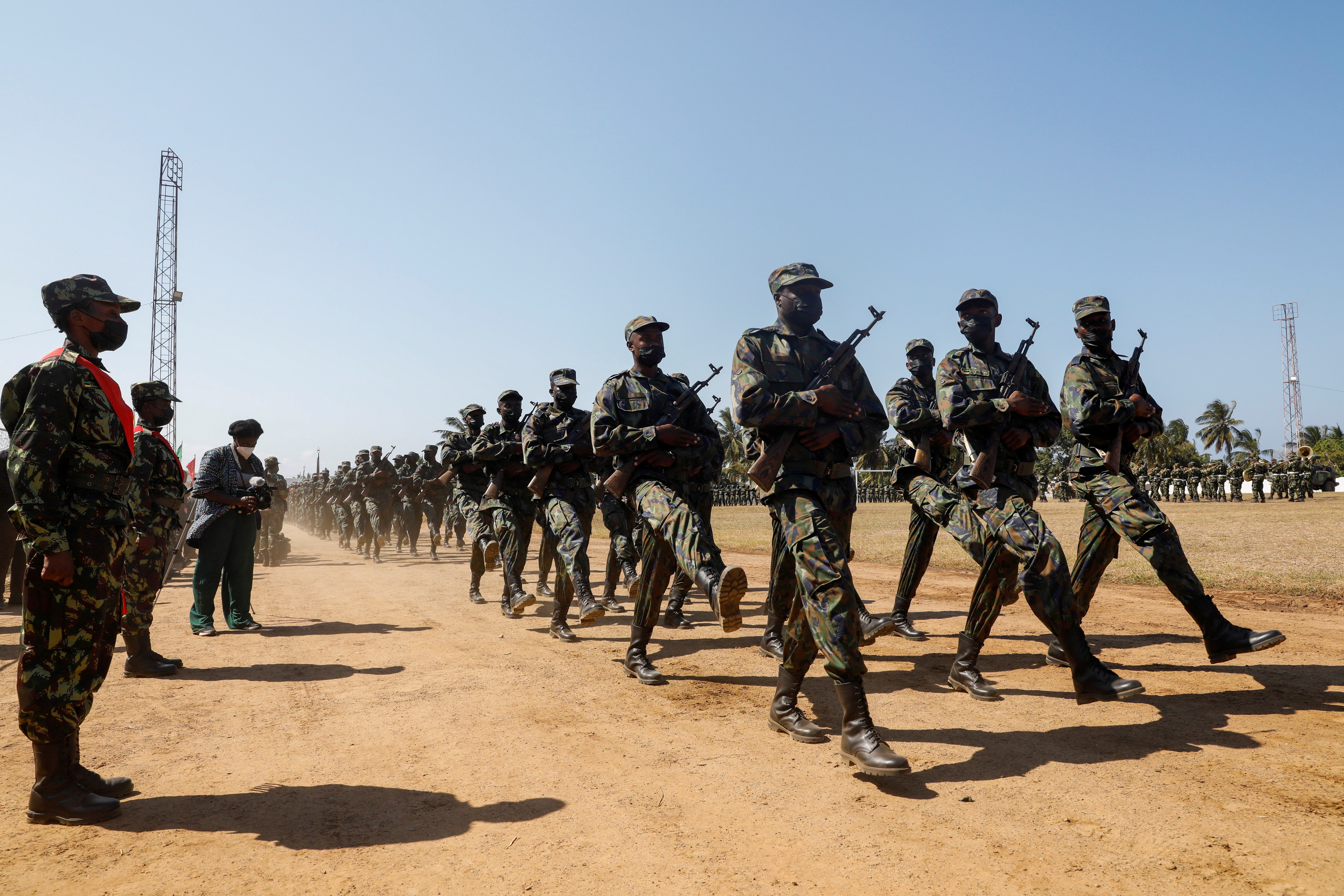 Mozambican soldiers march during Armed Forces Day celebrations in Pemba, Mozambique. September 25, 2021.REUTERS/Baz Ratner/File Photo