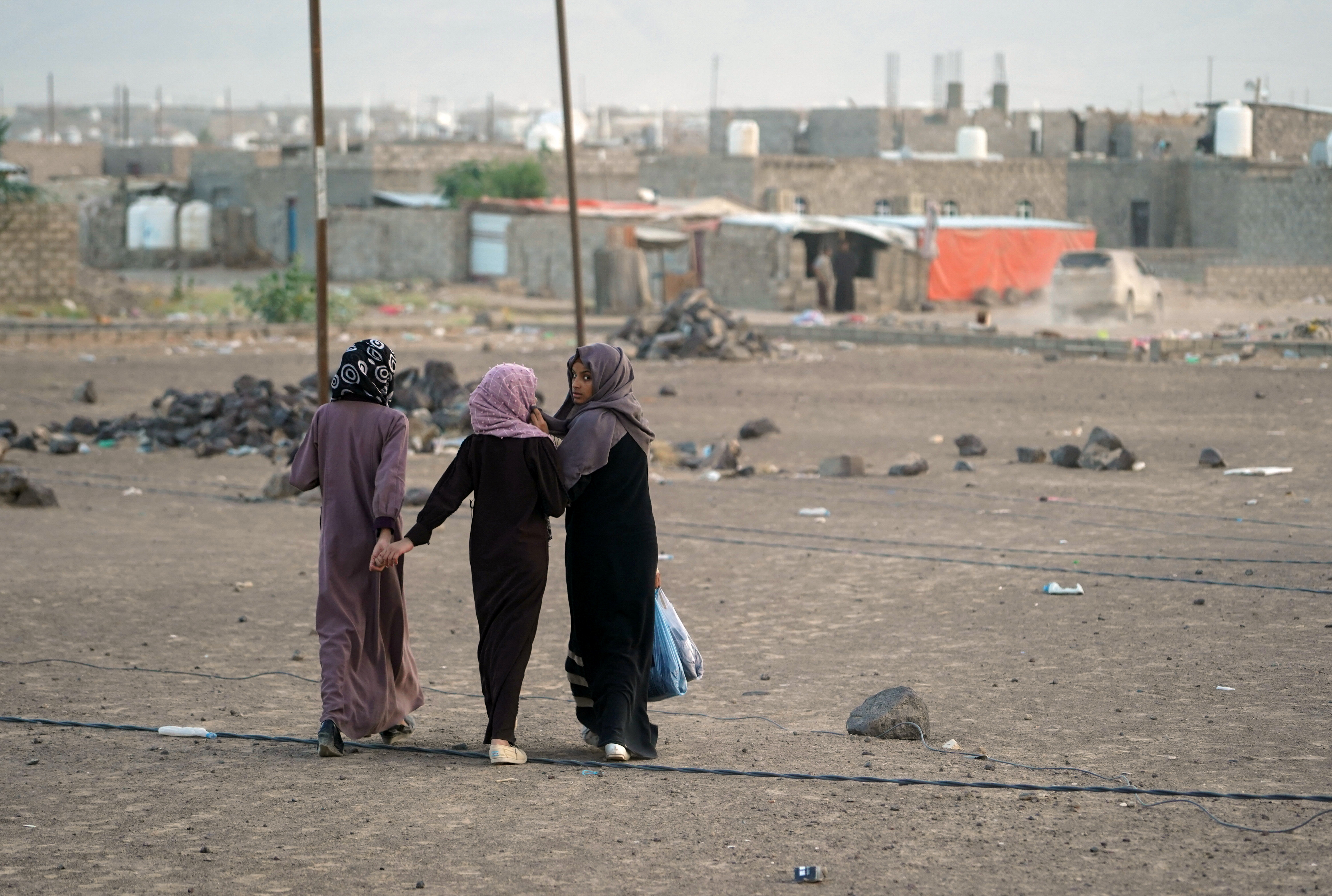 Girls walk at a makeshift camp for internally displaced people (IDPs) in the oil-producing Marib province, Yemen May 9, 2021. REUTERS/Nabeel al-Awzari
