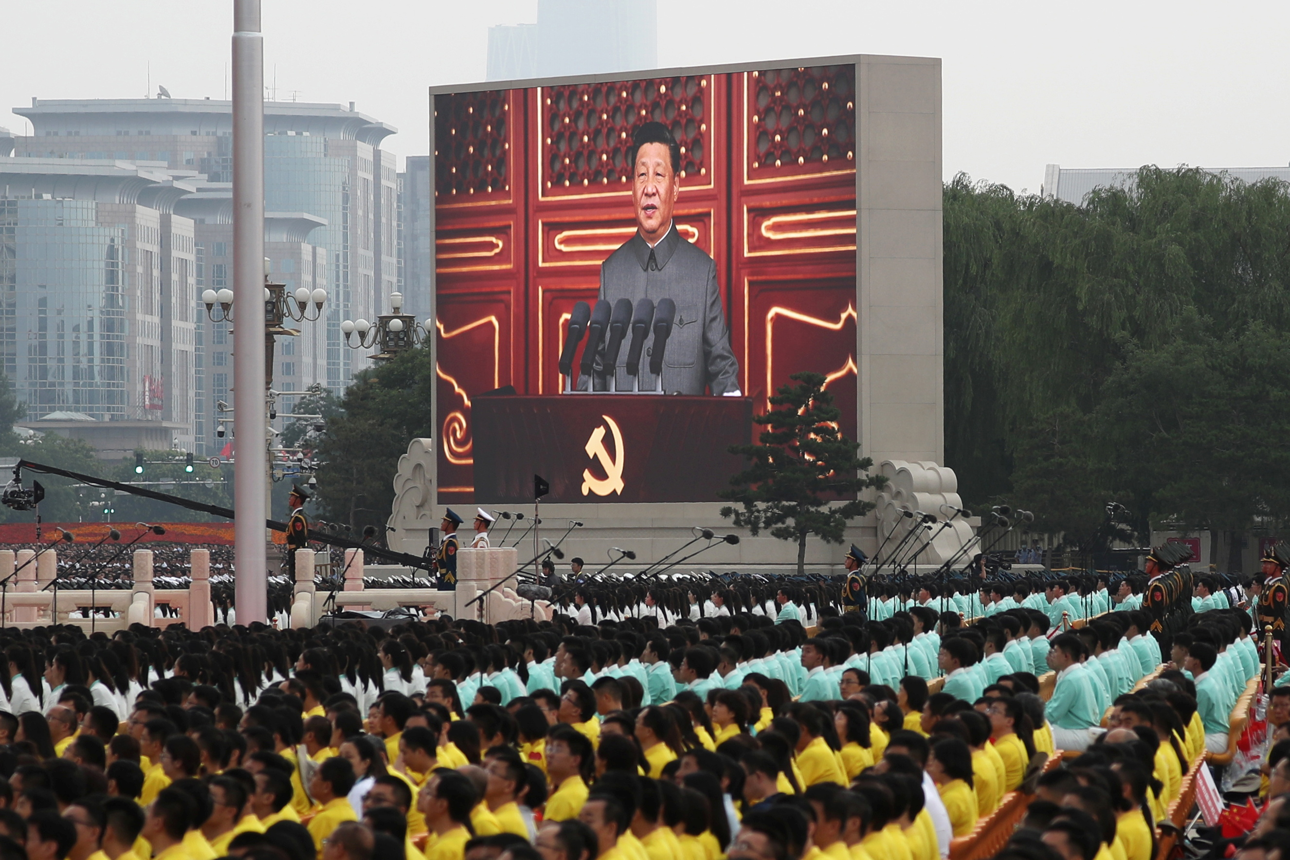 Chinese President Xi Jinping is seen on a giant screen as he delivers a speech at the event marking the 100th founding anniversary of the Communist Party of China, on Tiananmen Square in Beijing, China July 1, 2021. REUTERS/Carlos Garcia Rawlins