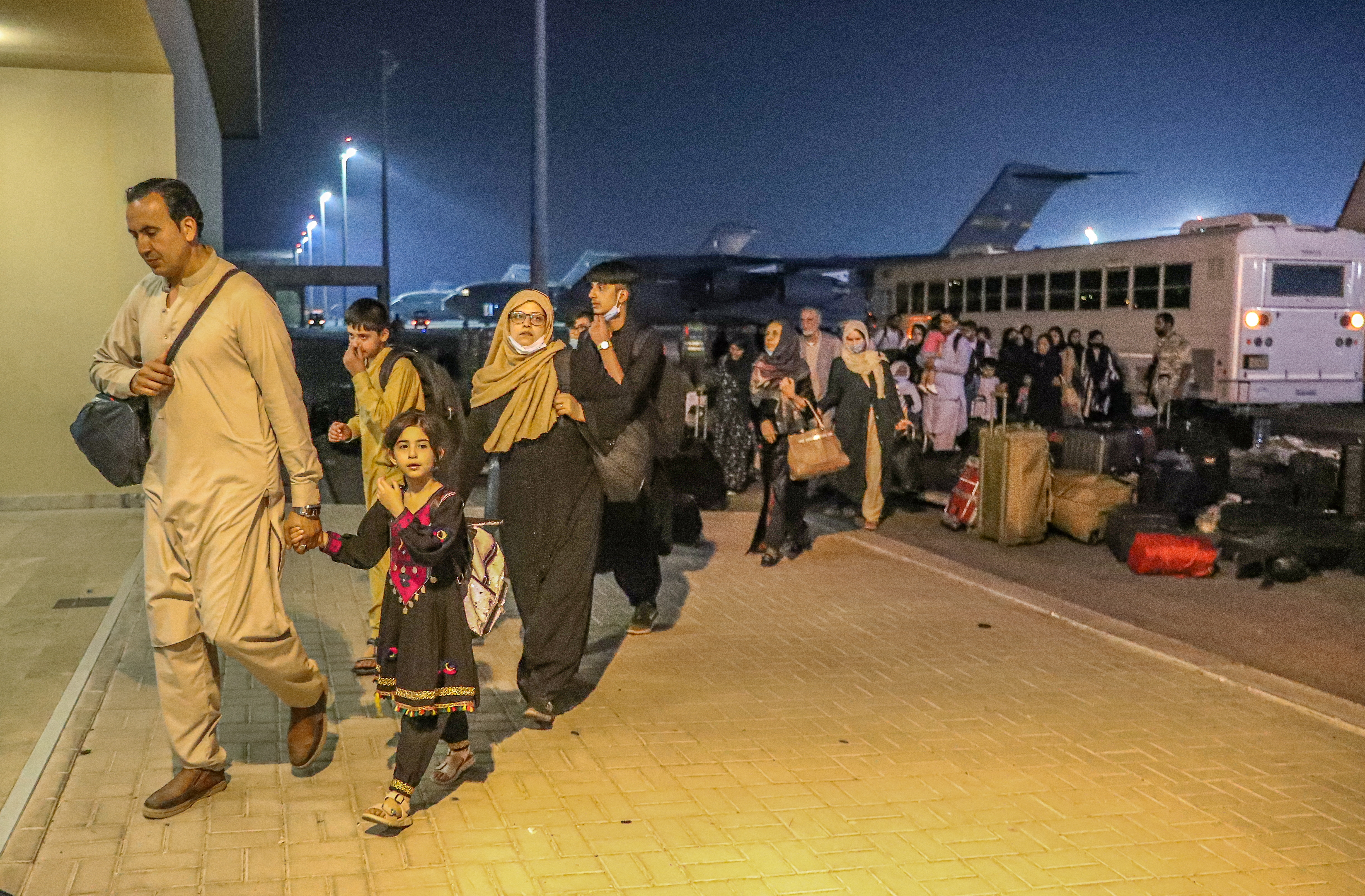 Evacuees from Afghanistan arrive at Al-Udeid airbase in Doha, Qatar in this recent undated handout. Government Communications Office of the State of Qatar/Handout via REUTERS