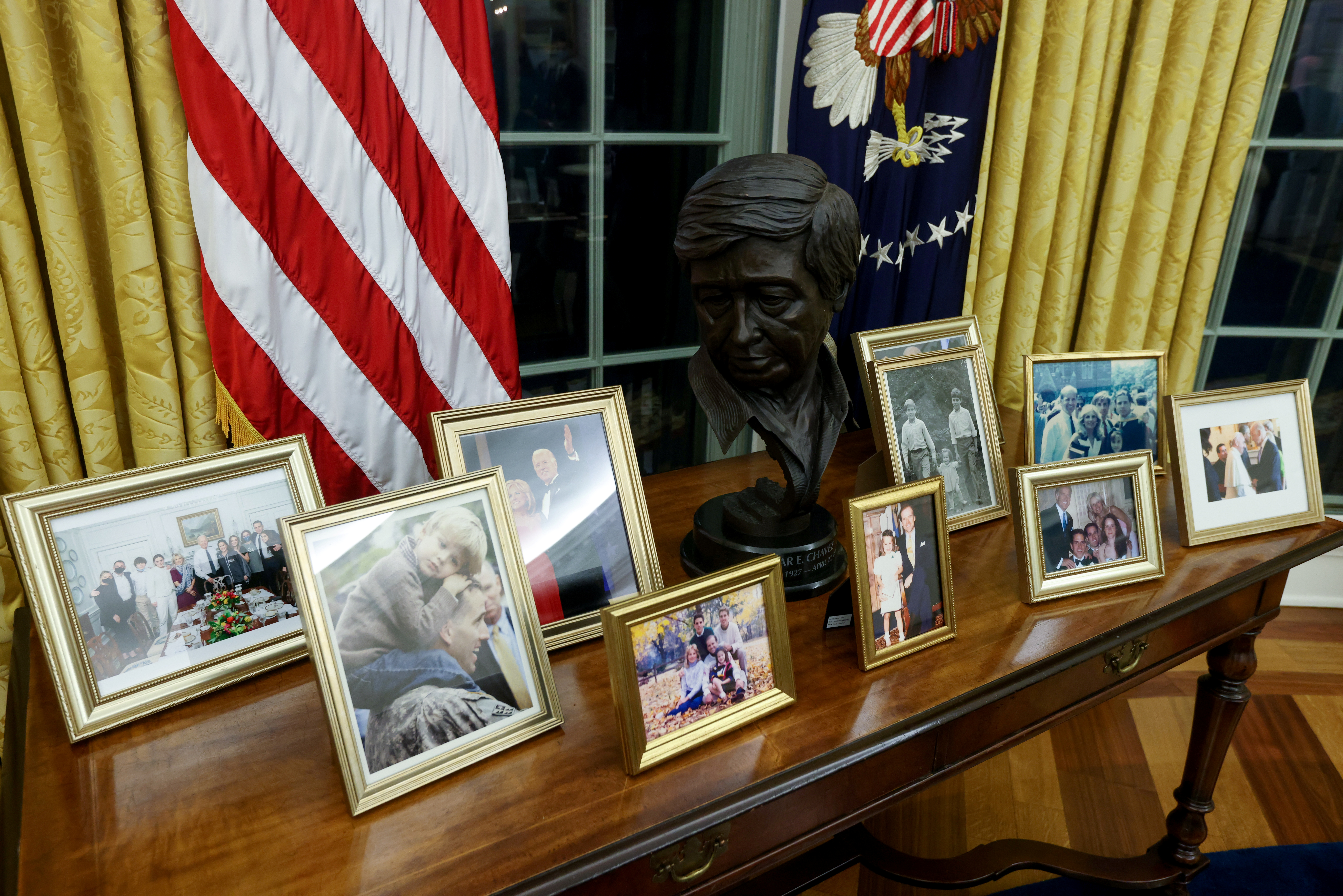 A bust of Mexican American labor leader Cesar Chavez joins family photos in the Oval Office, newly decorated for U.S. President Joe Biden at the White House in Washington, U.S. January 21, 2021.  REUTERS/Jonathan Ernst
