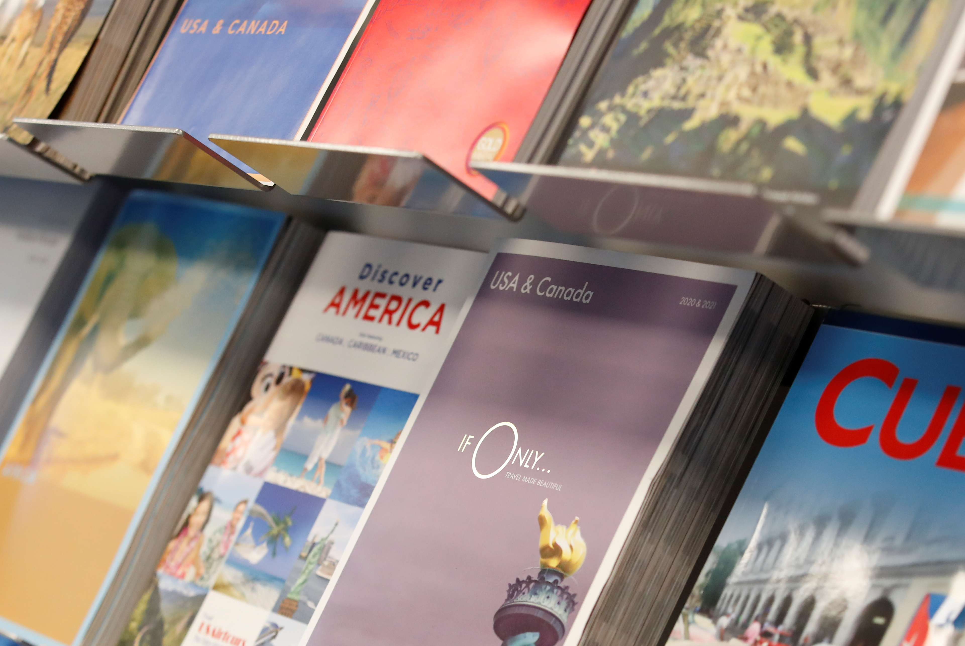 Travel brochures are seen at Bailey's Travel, in Wellingborough, Britain May 7, 2021. REUTERS/Andrew Boyers