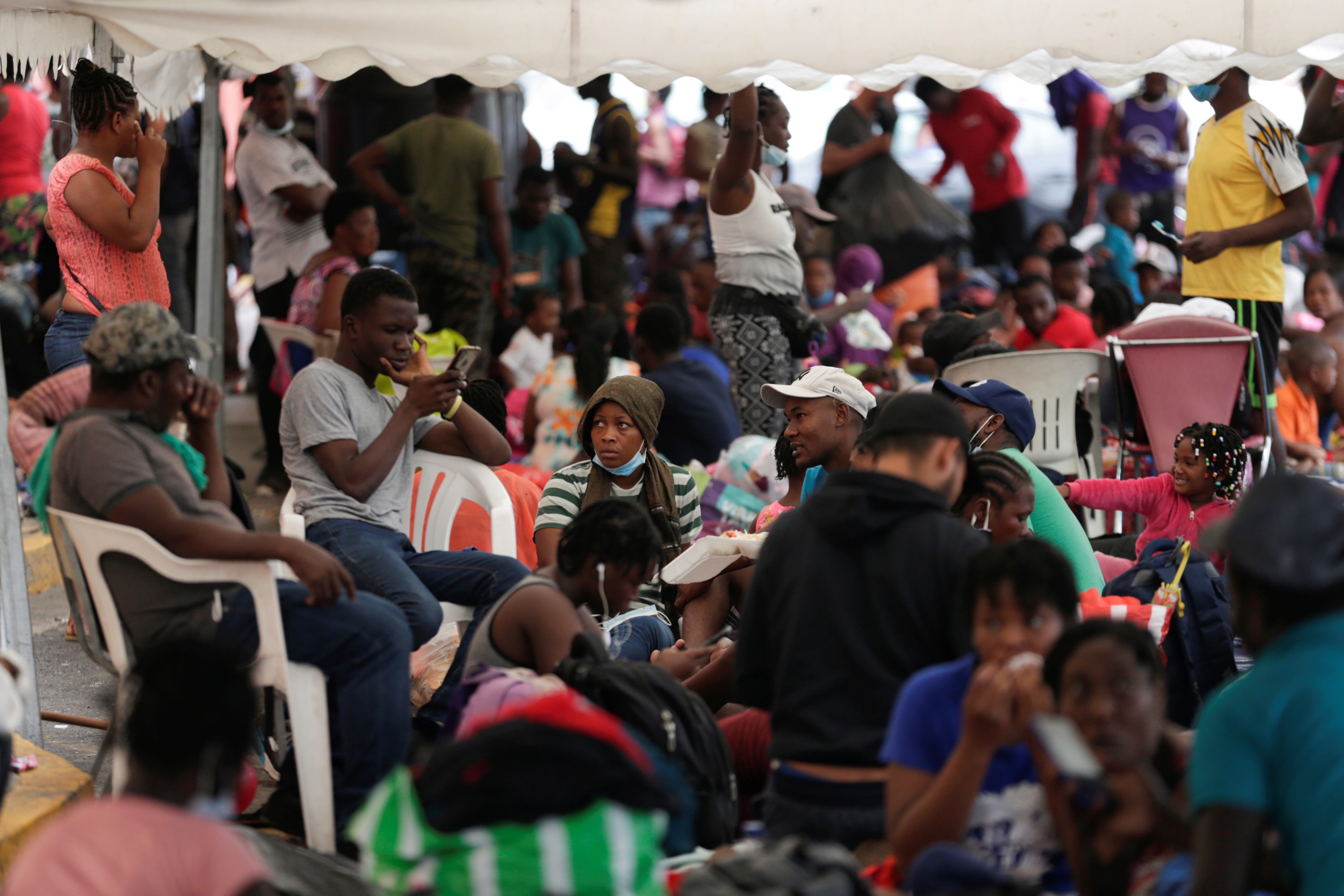 Haitian migrants seeking refuge in the U.S., rest outside the Casa INDI shelter as they try to reach the border with United States, in Monterrey, Mexico September 28, 2021. REUTERS/Daniel Becerril