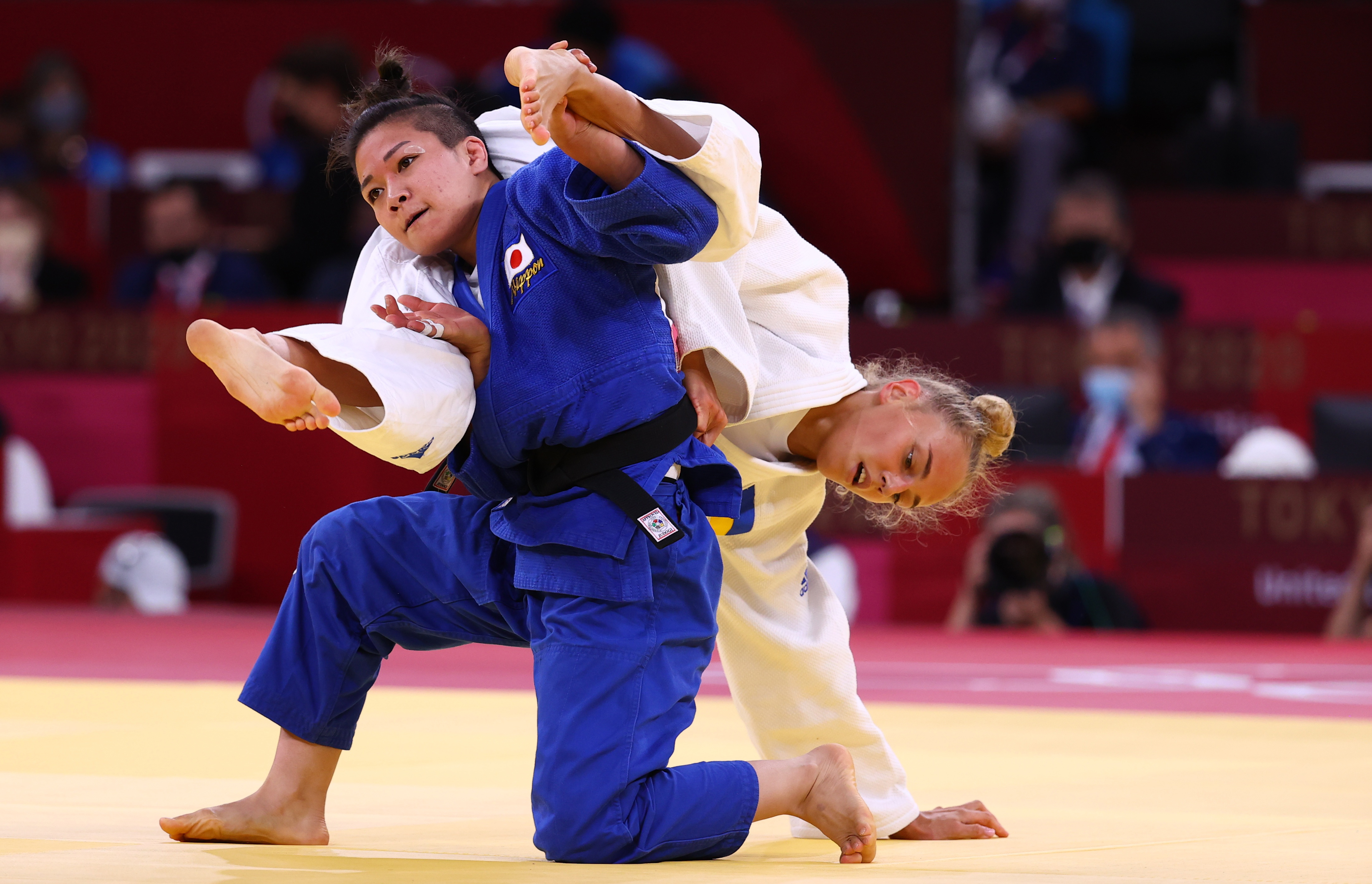 Tokyo 2020 Olympics - Judo -  Women's 48kg - Semifinal - Nippon Budokan - Tokyo, Japan - July 24, 2021. Daria Bilodid of Ukraine in action against Funa Tonaki of Japan REUTERS/Sergio Perez