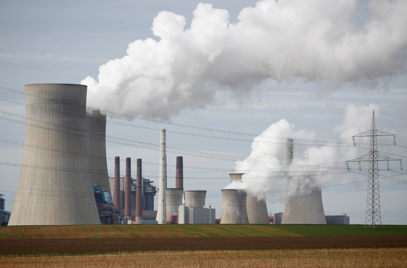 Steam rises from the five brown coal-fired power units of RWE, one of Europe's biggest electricity companies in Neurath, north-west of Cologne, Germany March 12, 2019. REUTERS/Wolfgang Rattay/File Photo