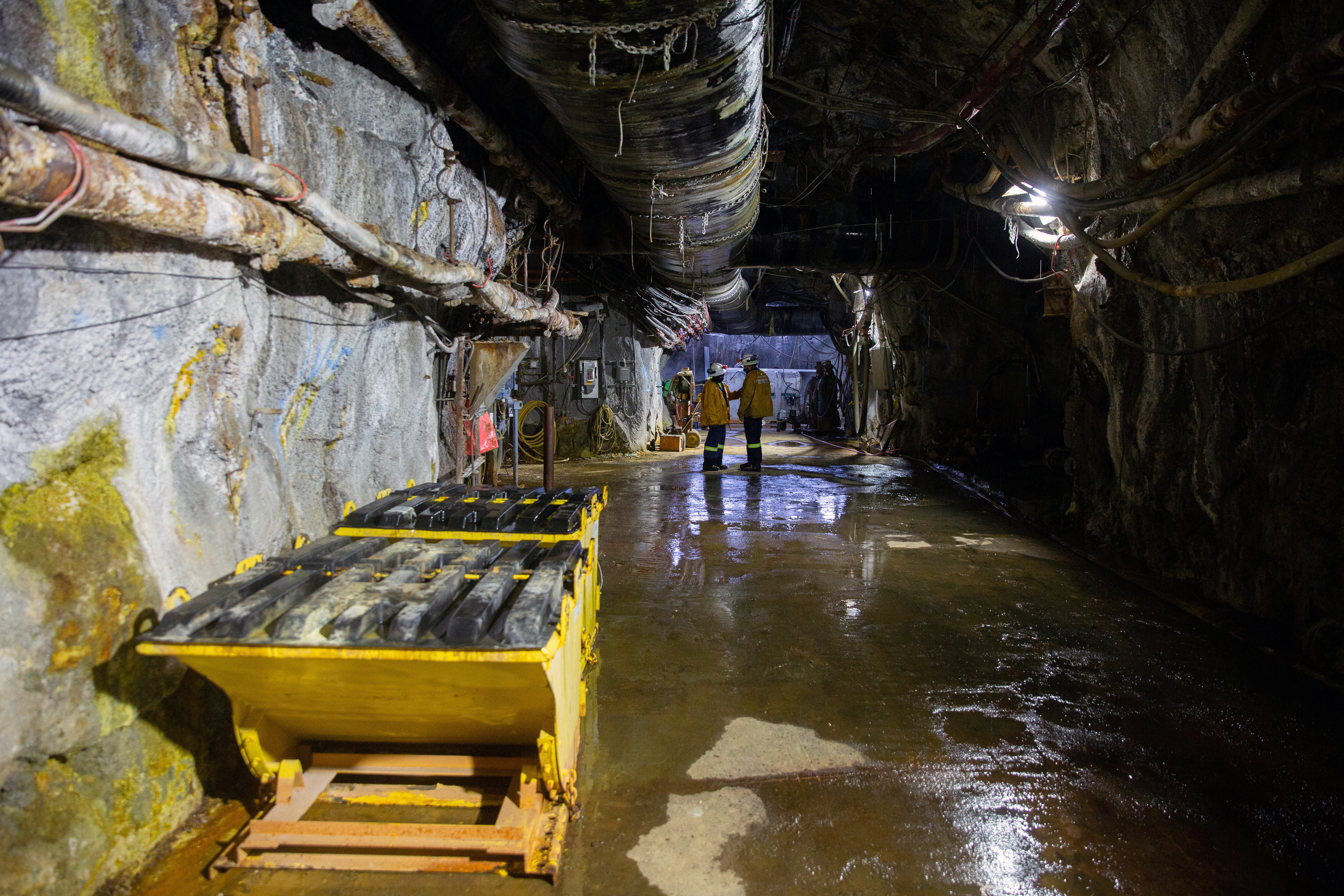 Mine workers talk 6780 ft (2066 m) underground in the Resolution Copper exploratory mine shaft 10 in Superior, Arizona, U.S., March 30, 2021. Picture taken March 30, 2021.  REUTERS/Caitlin O'Hara