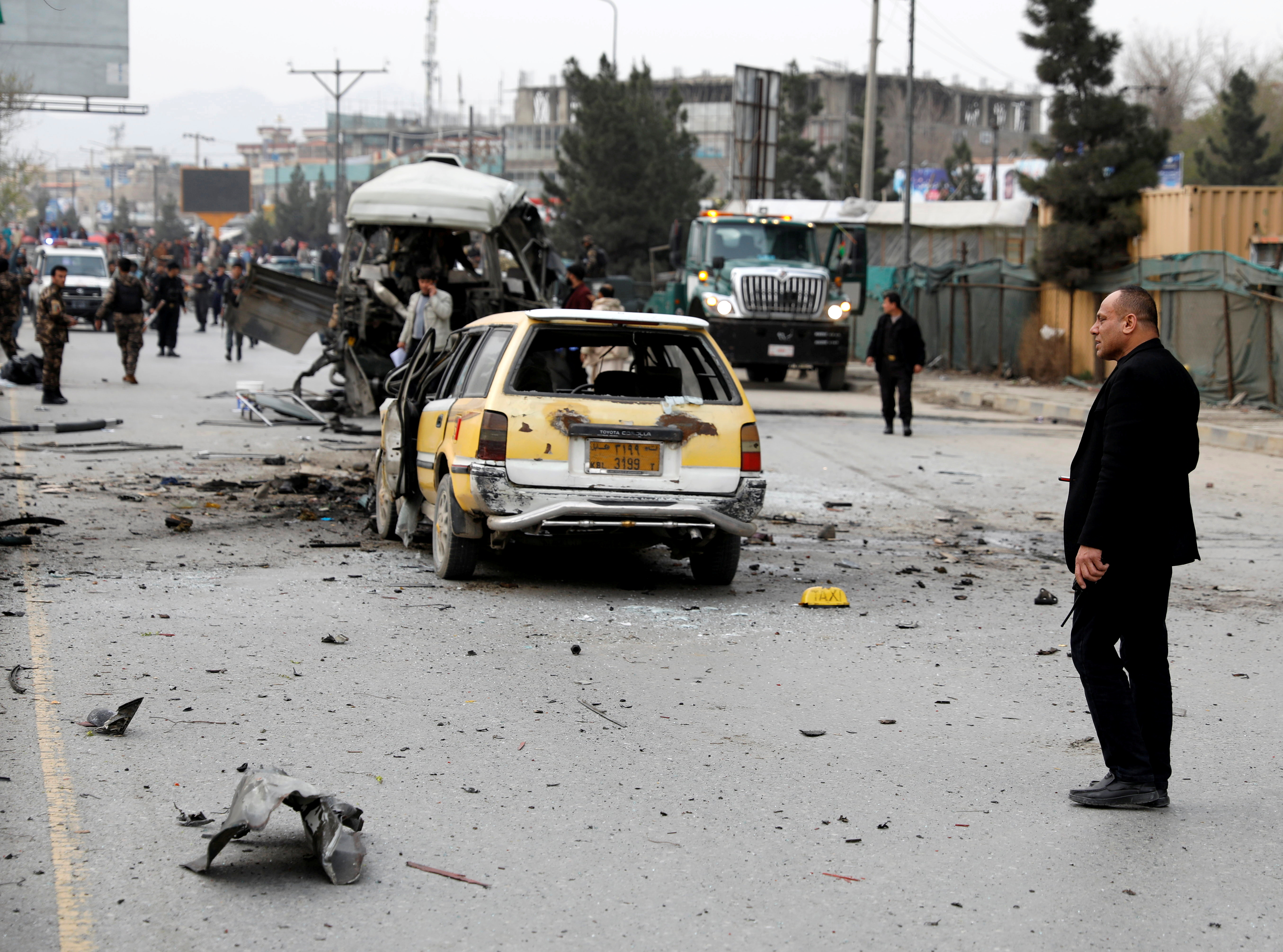 Afghan officials inspect a damaged minibus after a blast in Kabul, Afghanistan March 15, 2021. REUTERS/Mohammad Ismail/File Photo