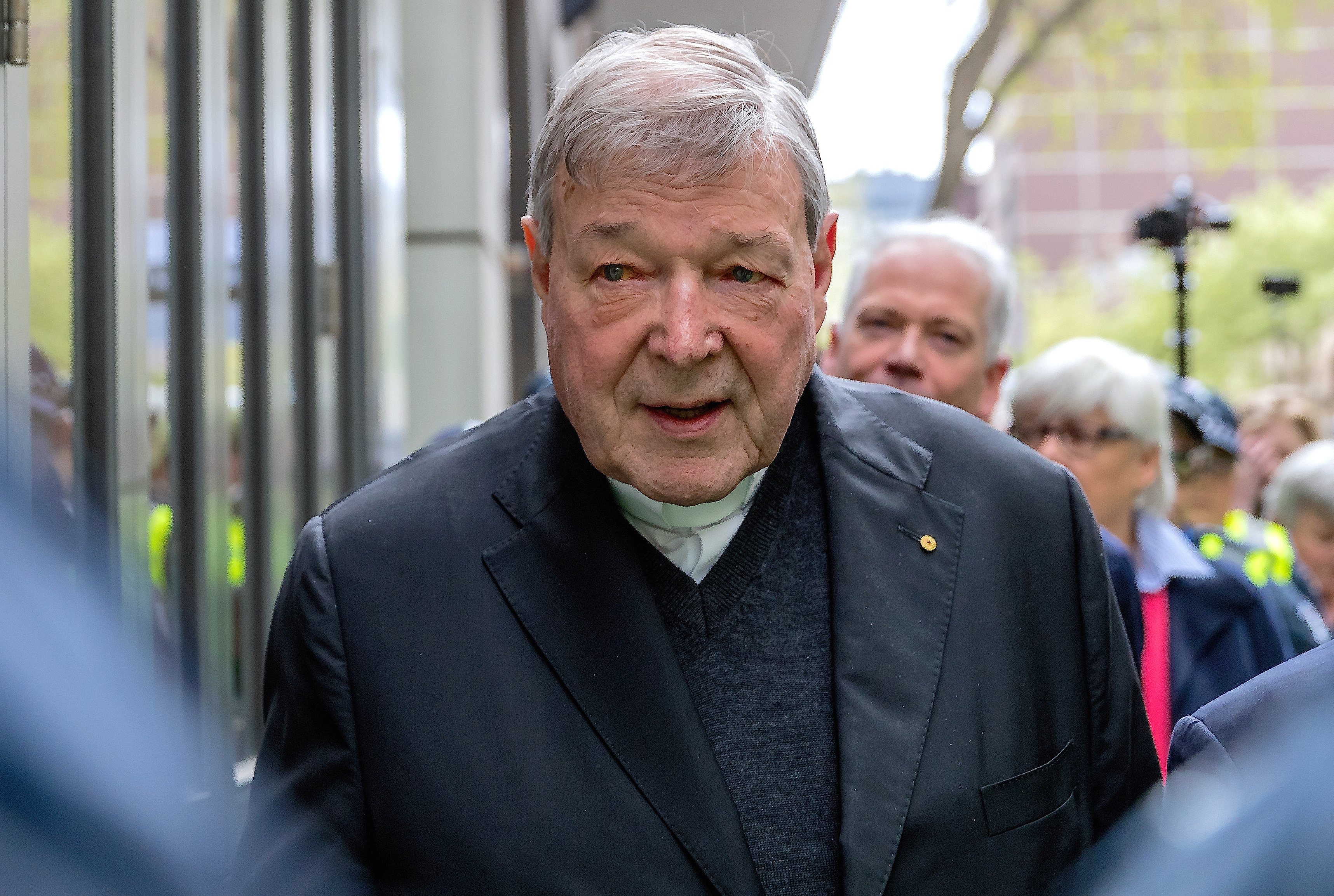 FILE PHOTO - Vatican Treasurer Cardinal George Pell is surrounded by Australian police as he leaves the Melbourne Magistrates Court in Australia, October 6, 2017.    REUTERS/Mark Dadswell