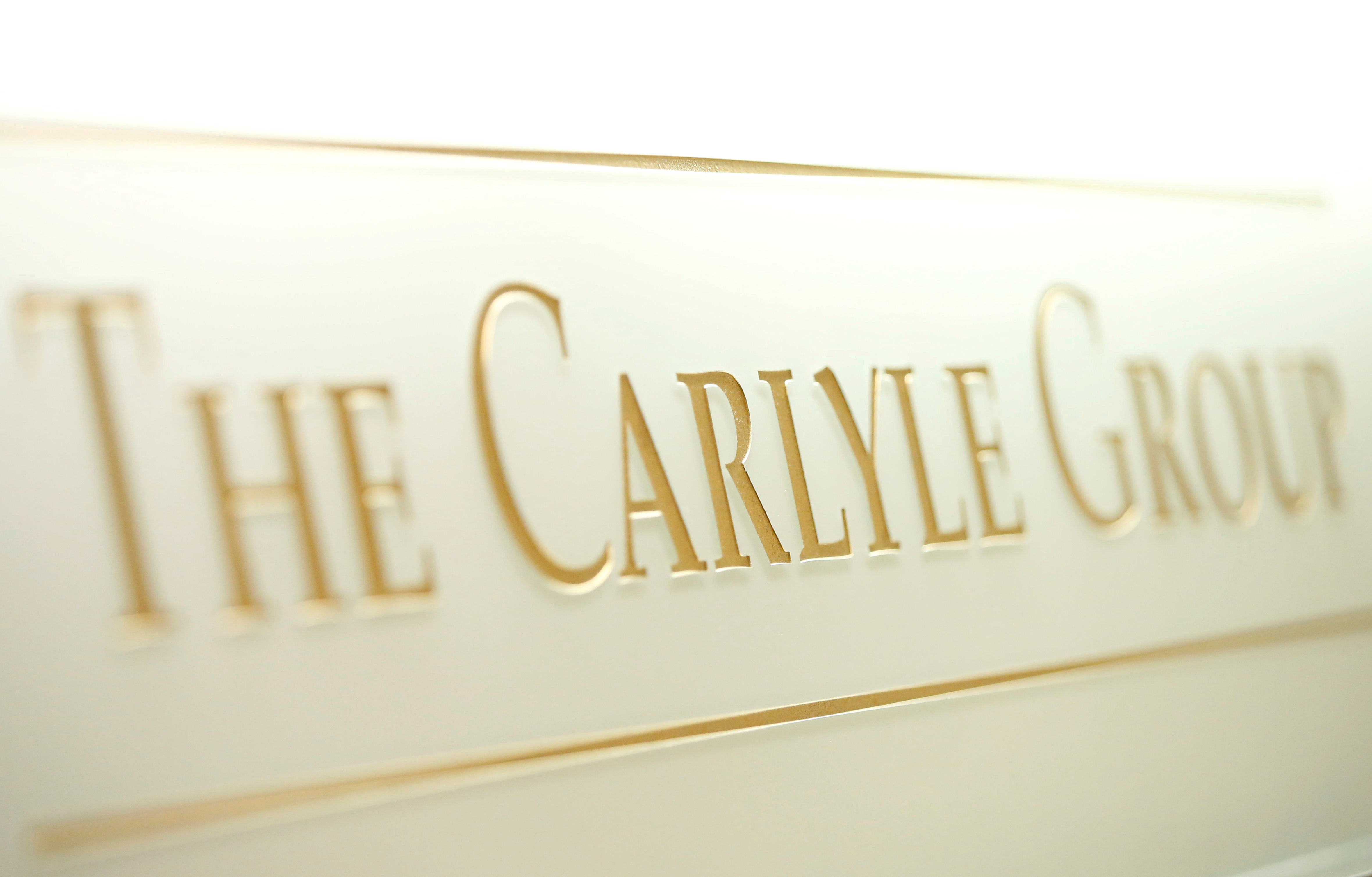 The logo of the Carlyle Group is displayed at the company's office in Tokyo, Japan October 17, 2018. REUTERS/Issei Kato