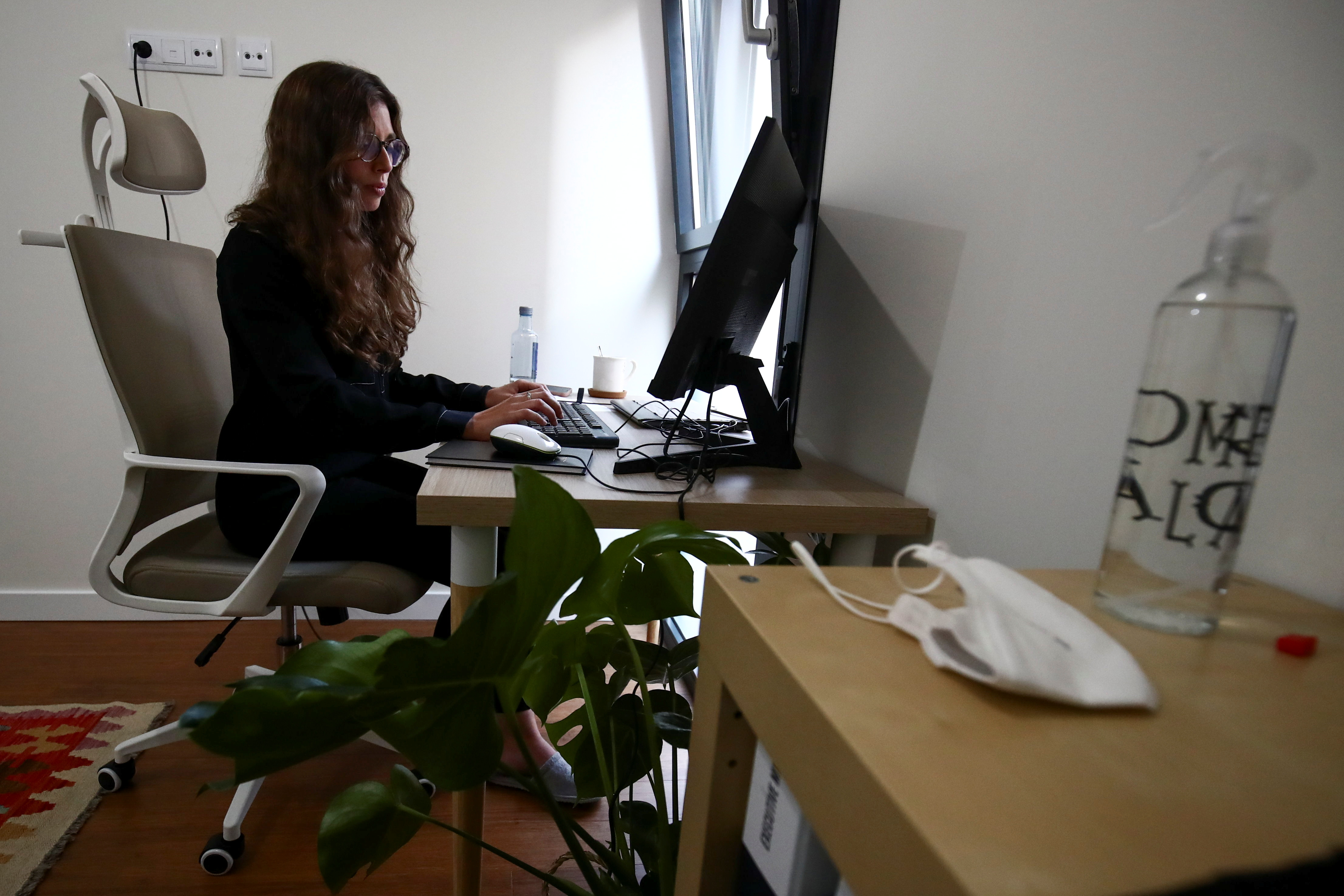 Blanca Lorca wears a casual outfit as she works at her home in Madrid, Spain, September 30, 2021. REUTERS/Sergio Perez